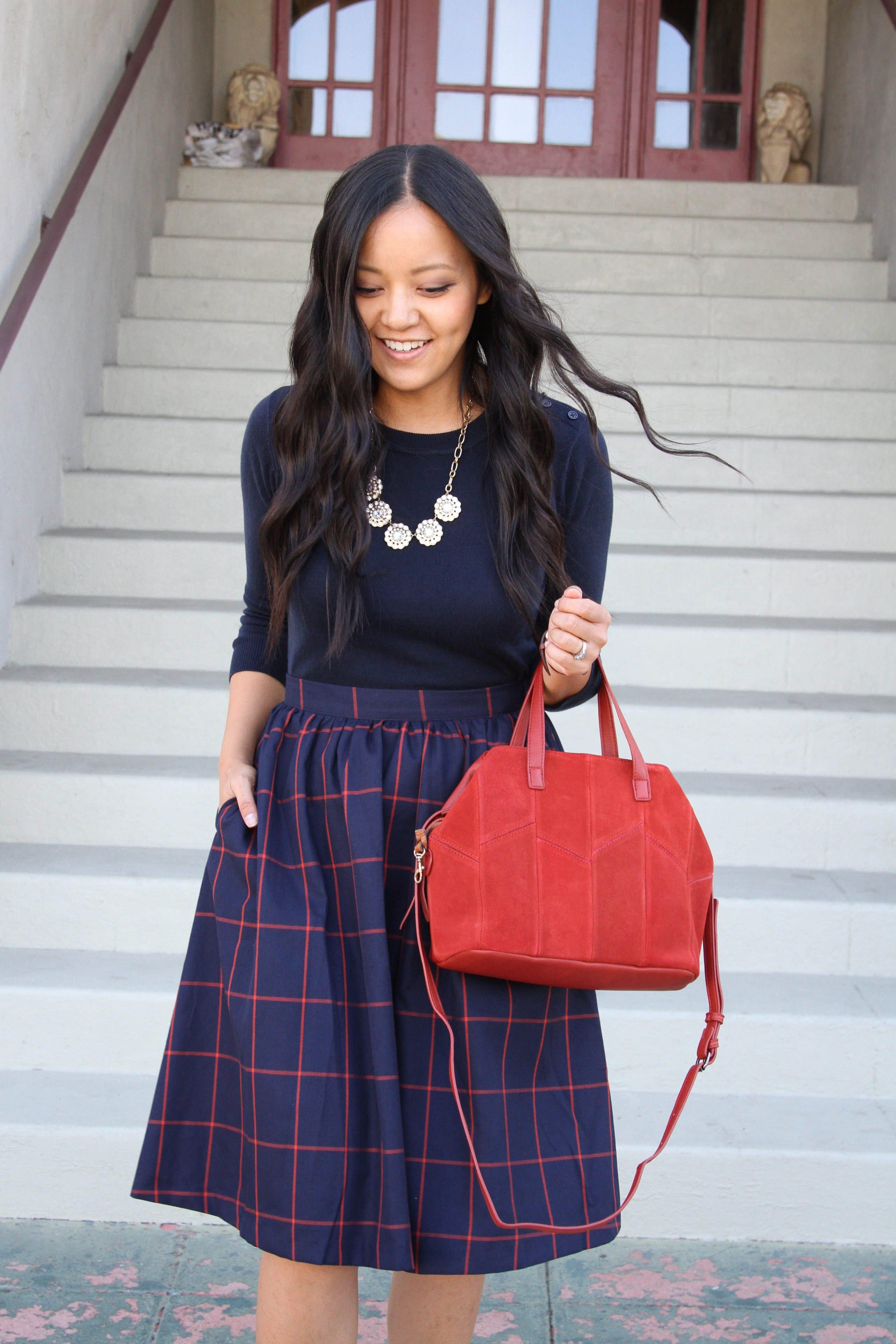 business casual outfit + Plaid Skirt + Navy Top + Red Bag + Statement Necklace