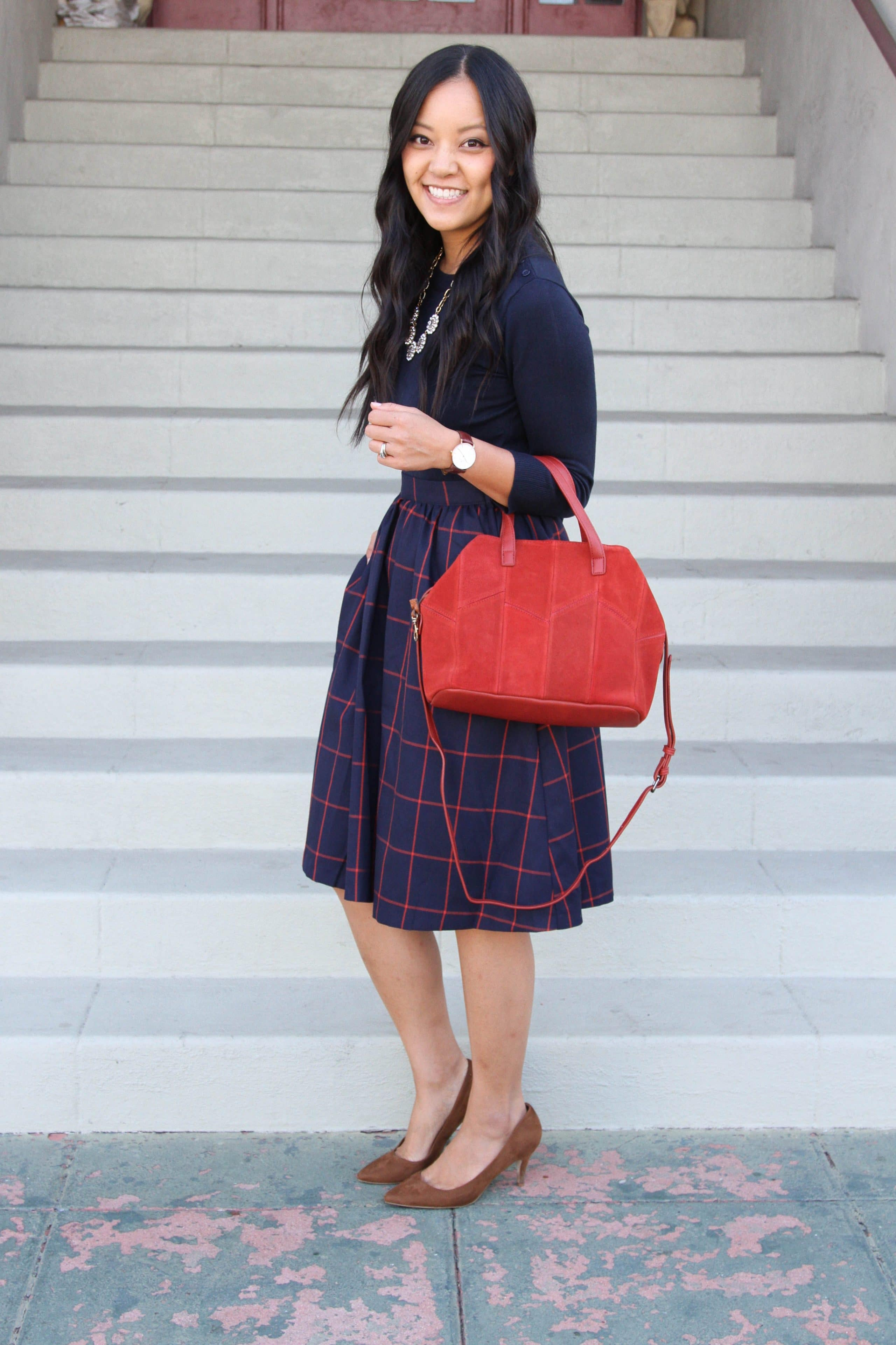Red Bag + Blue and Red Skirt + Navy Sweater + Pumps + Statement Necklace