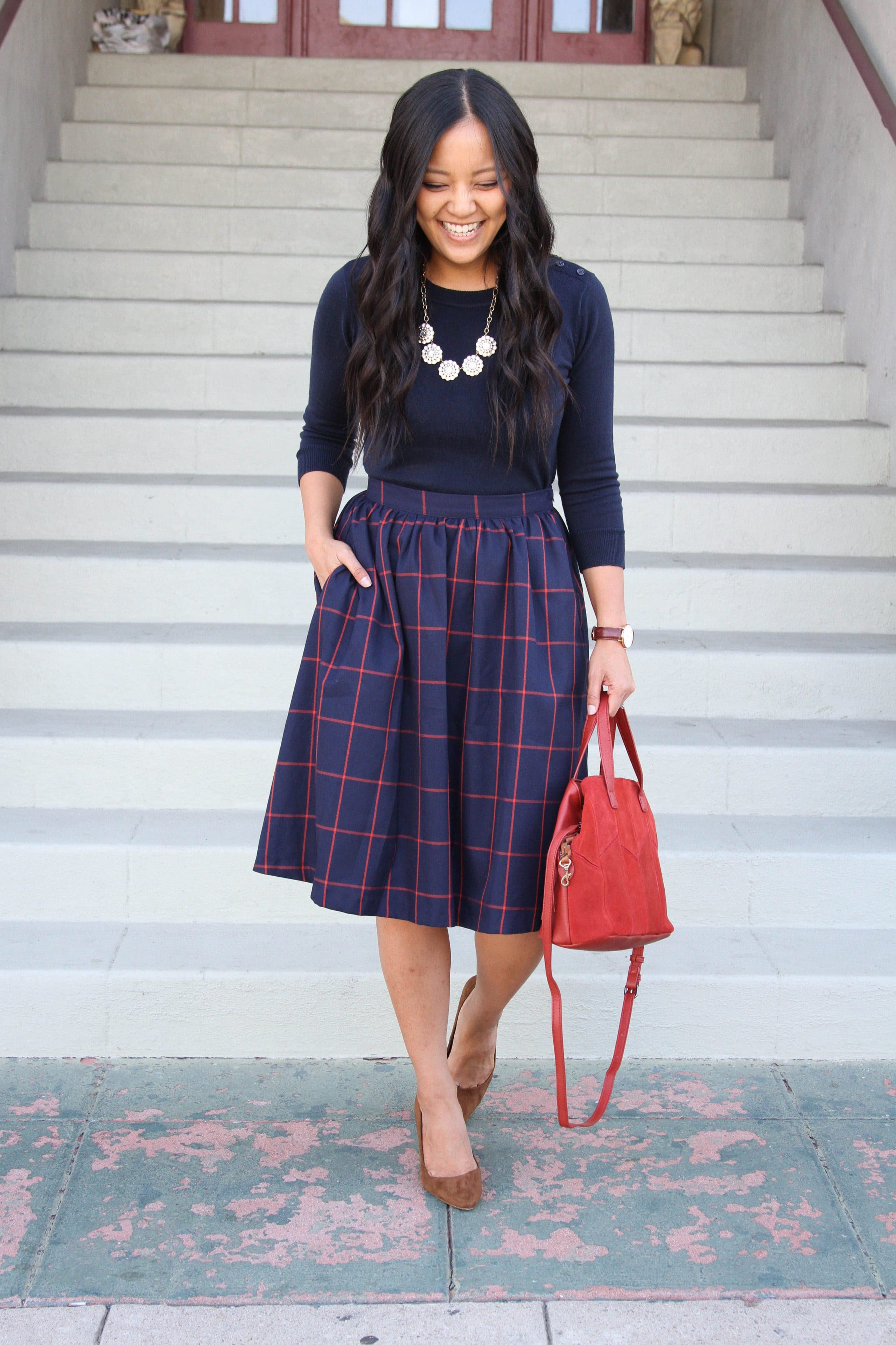 business casual outfit + Pullover Sweater + Blue midi skirt + Red bag + Pumps + Statement Necklace