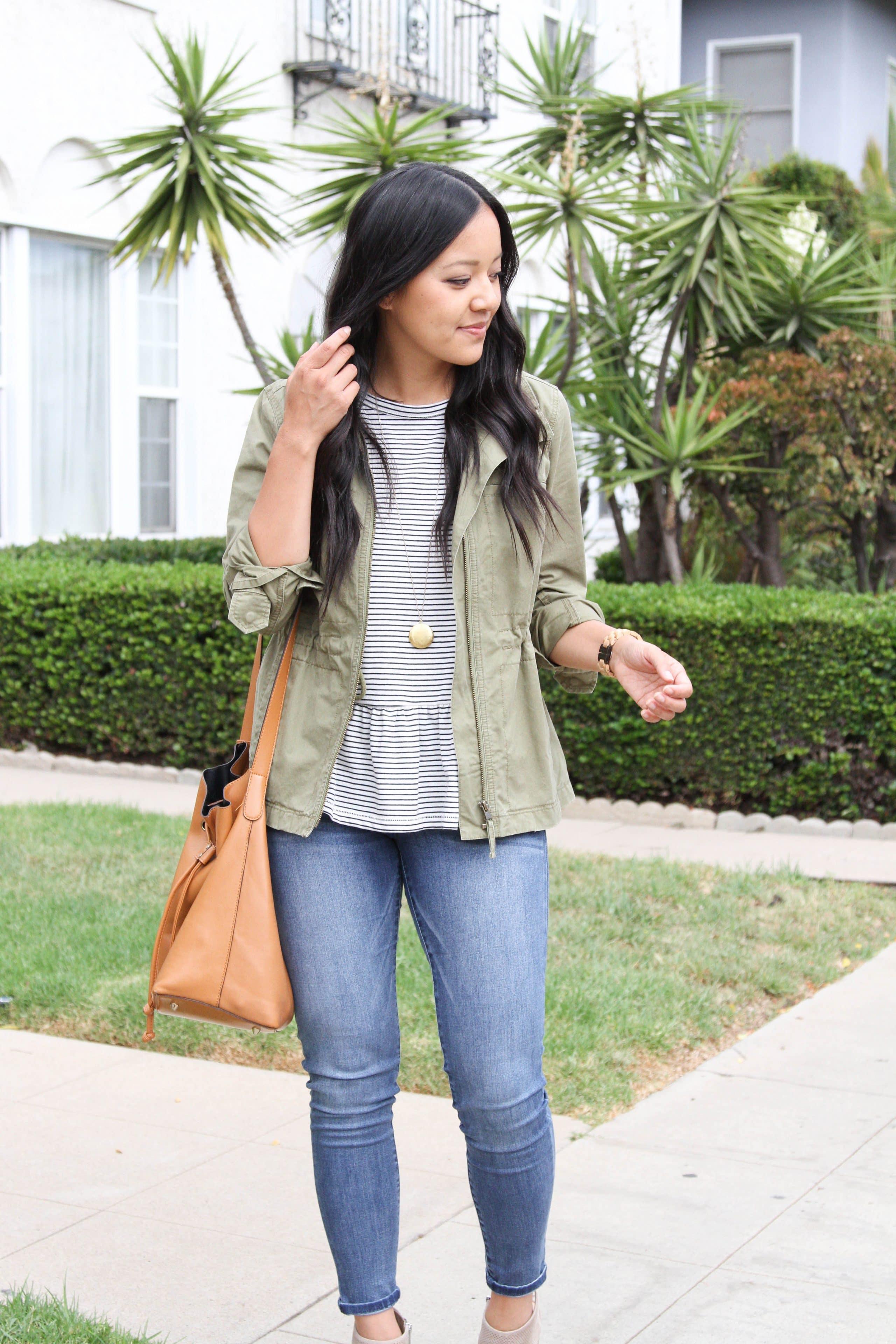 Utility Jacket + Striped Peplum + Light Jeans + Tan Bag + Gold Pendant