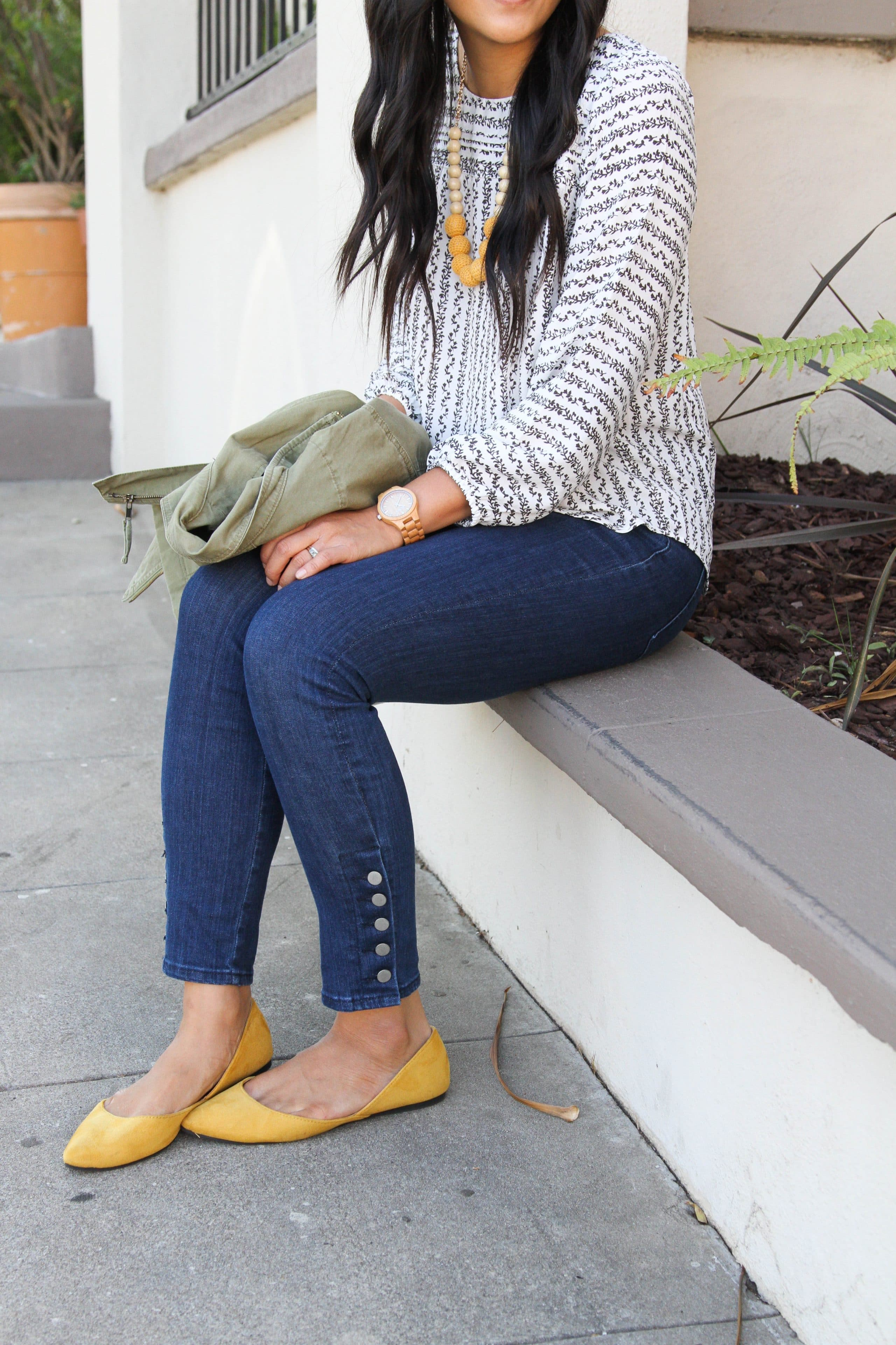 Skinny jeans with buttons + White blouse with flowers + Mustard Flats + Utility Jacket