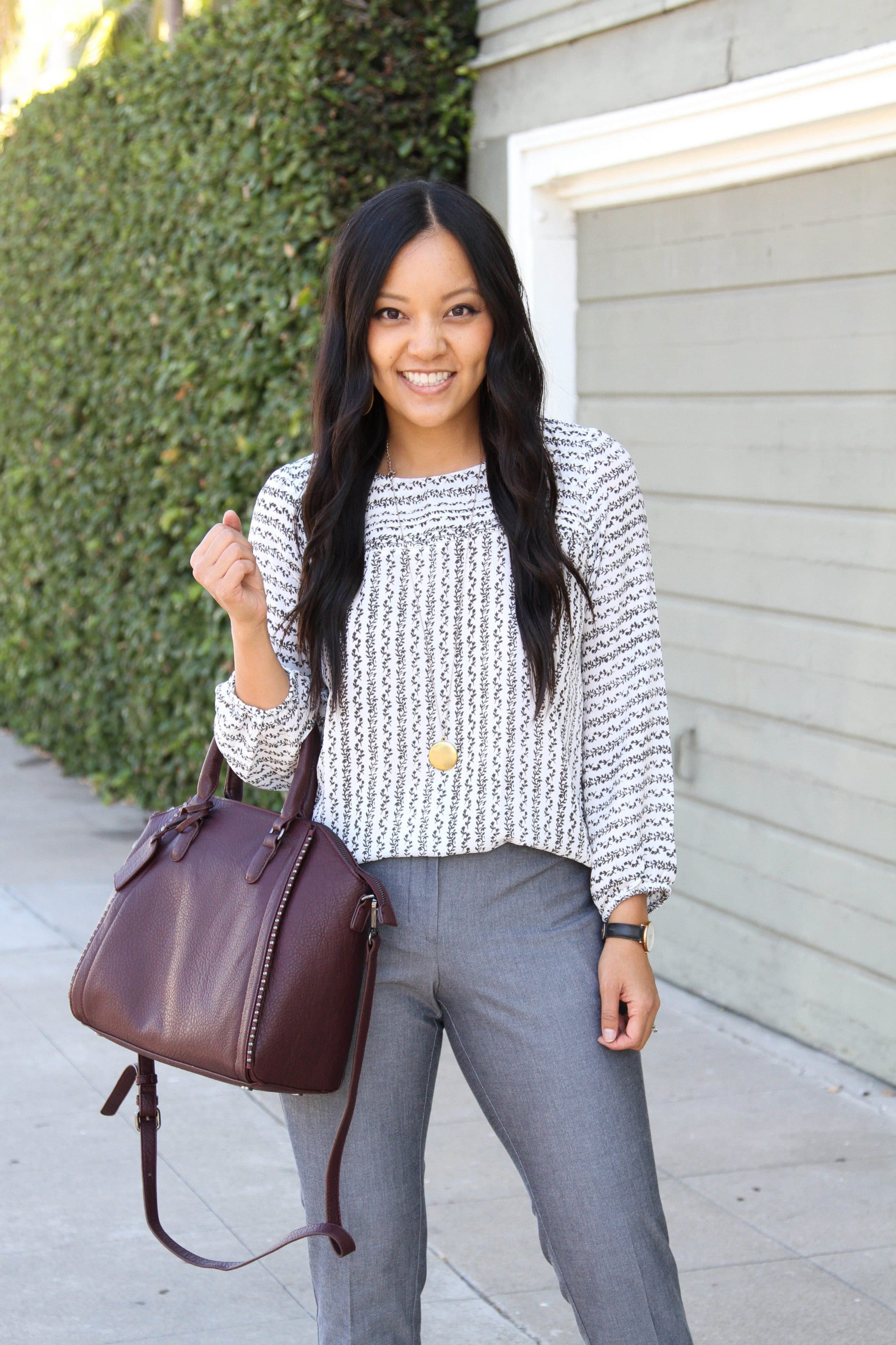Business Casual Outfit: maroon bag + gray pants + Floral blouse + gold pendant