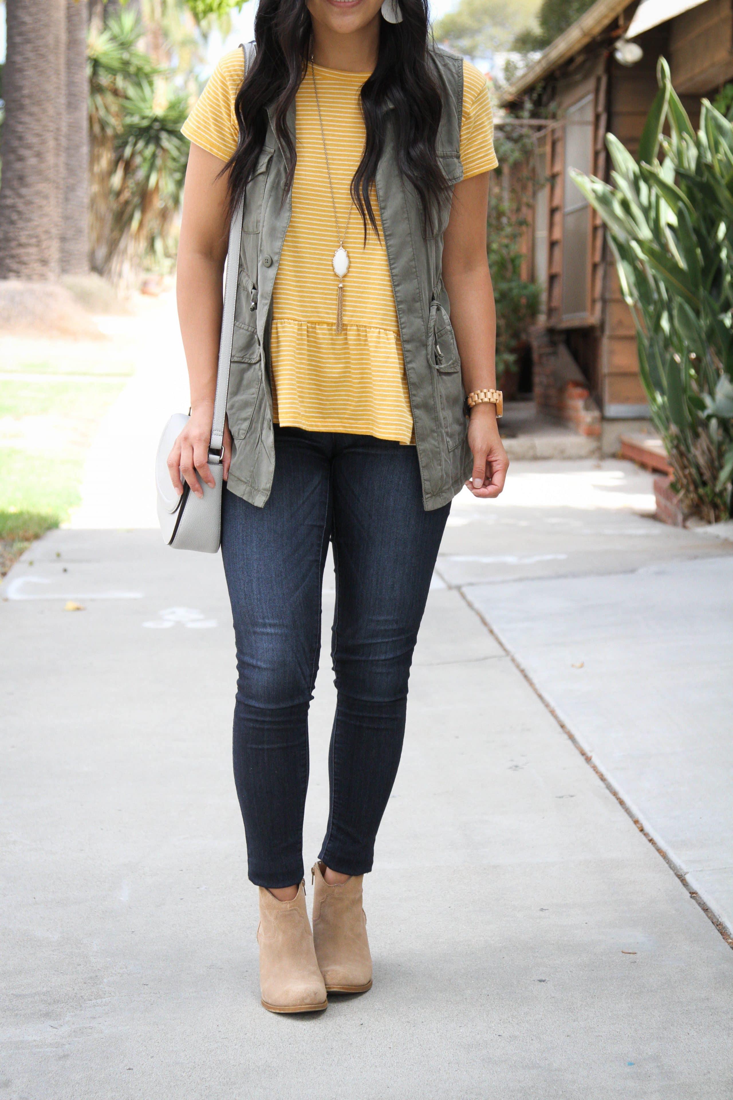 Denim Skinnies + Yellow Peplum Tee + Utility Vest + Taupe Booties + Gray Bag