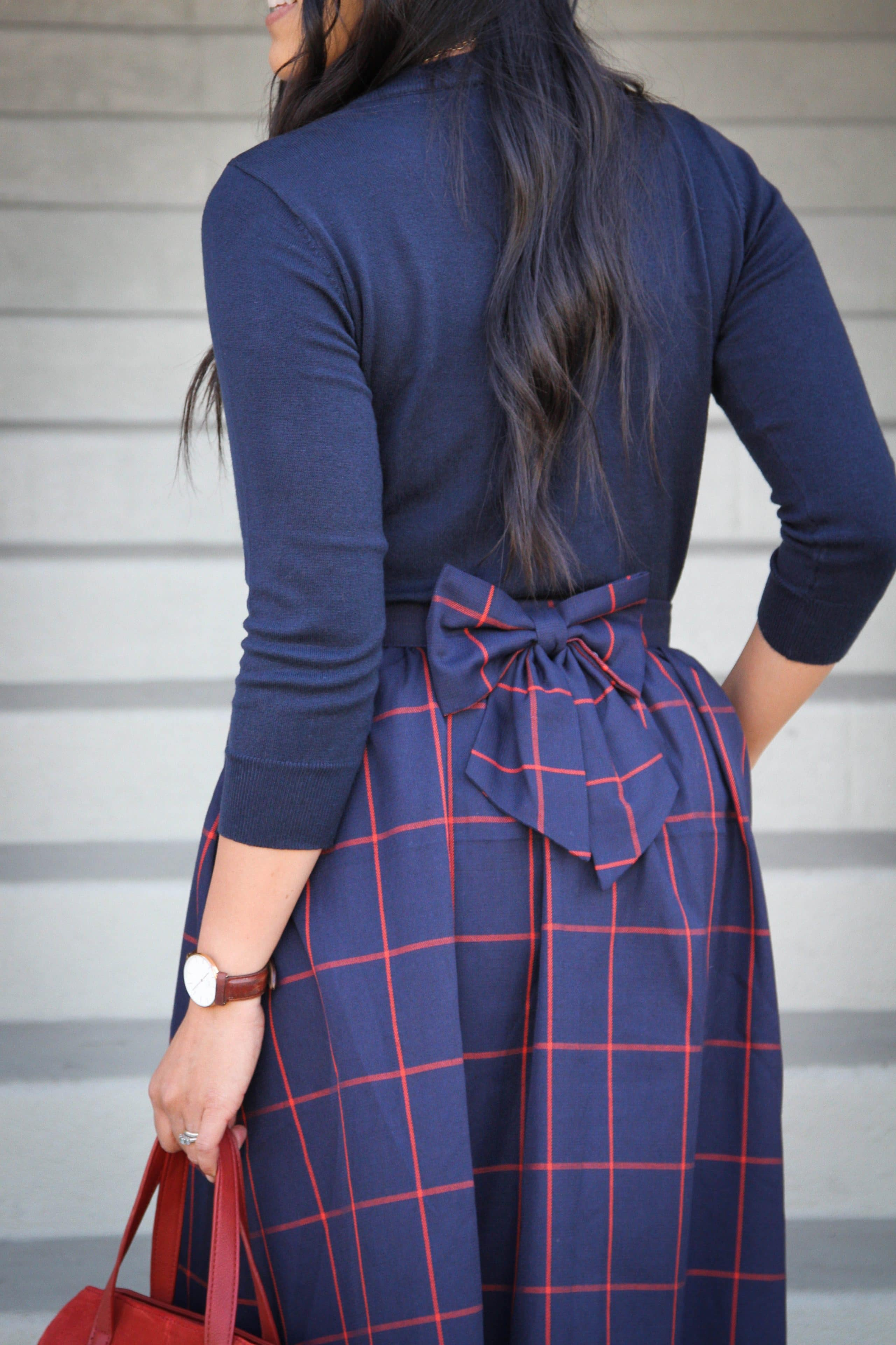 Navy Sweater + Bow detail back of skirt