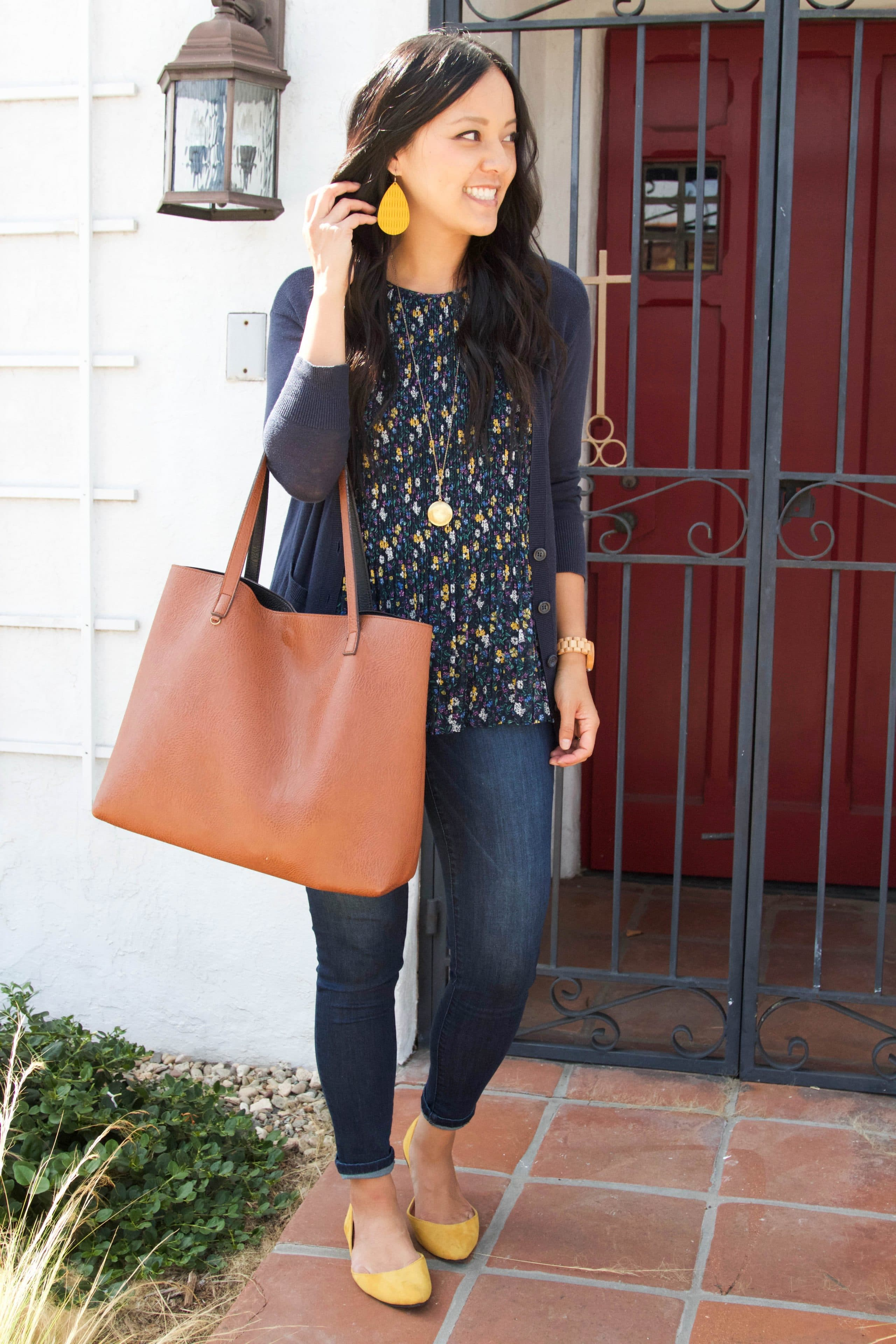 Skinnies + Tote + Floral Blouse + Navy Cardigan + Yellow Accessories