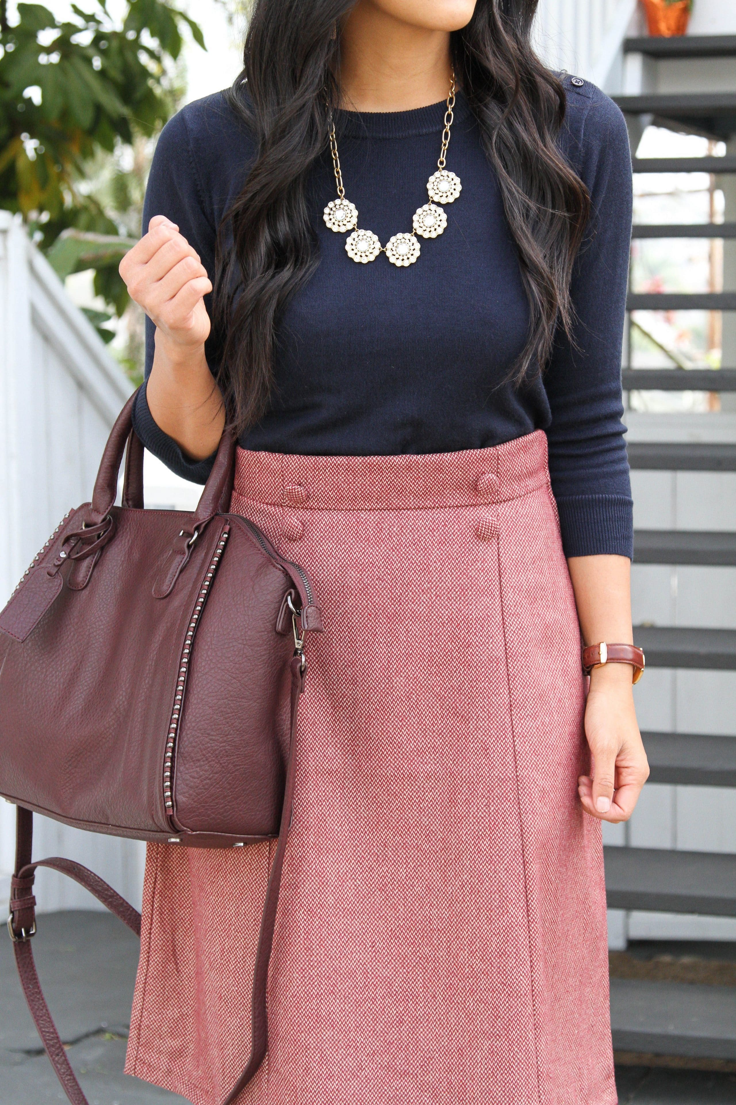 High Waisted Skirt + Navy Sweater + Wine Colored Bag + Statement Necklace
