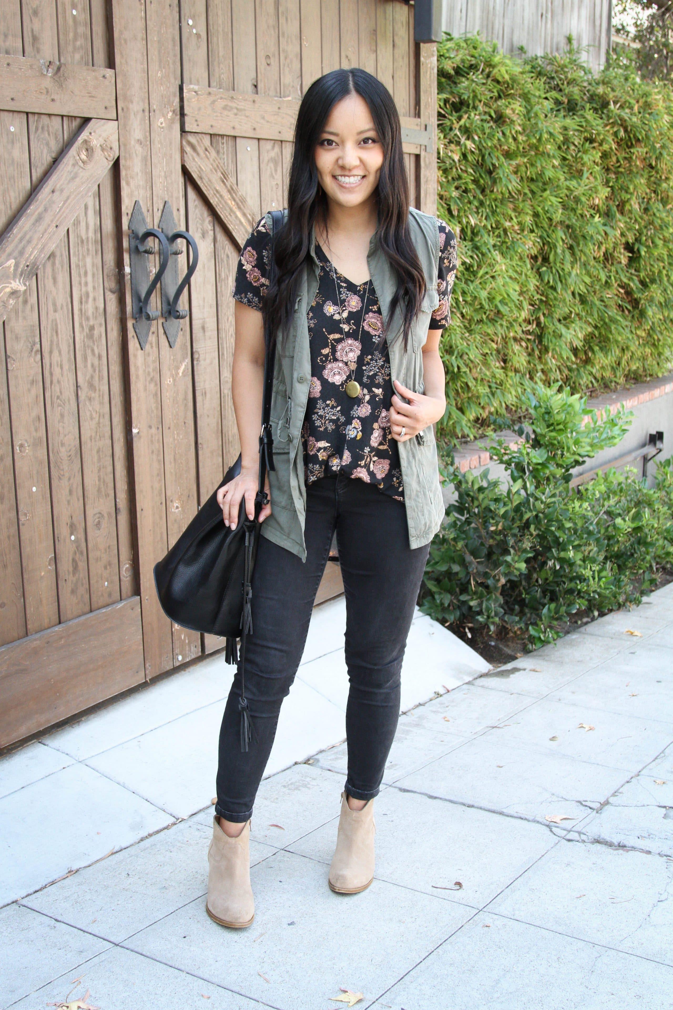 Black floral top + Utility Vest + Black Jeans + Taupe Booties + black bag
