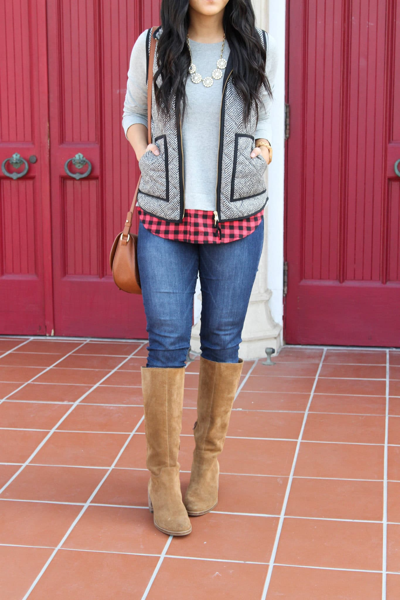 Herringbone Vest + Grey Sweater Buffalo Check + Riding Boots + Brown Bag + Statement Necklace