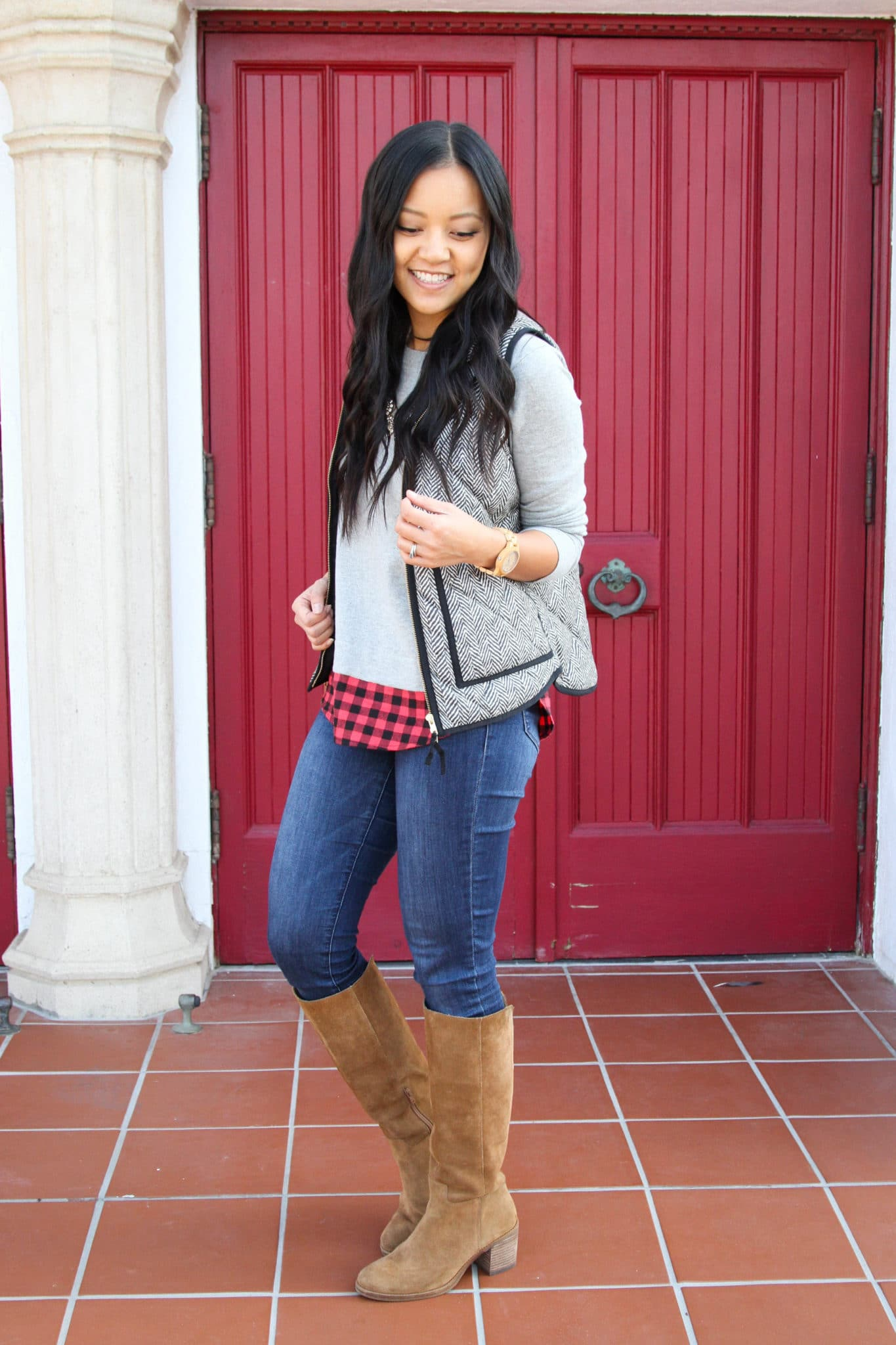 Vest + Grey Sweater + Skinnies + Suede Riding Boots