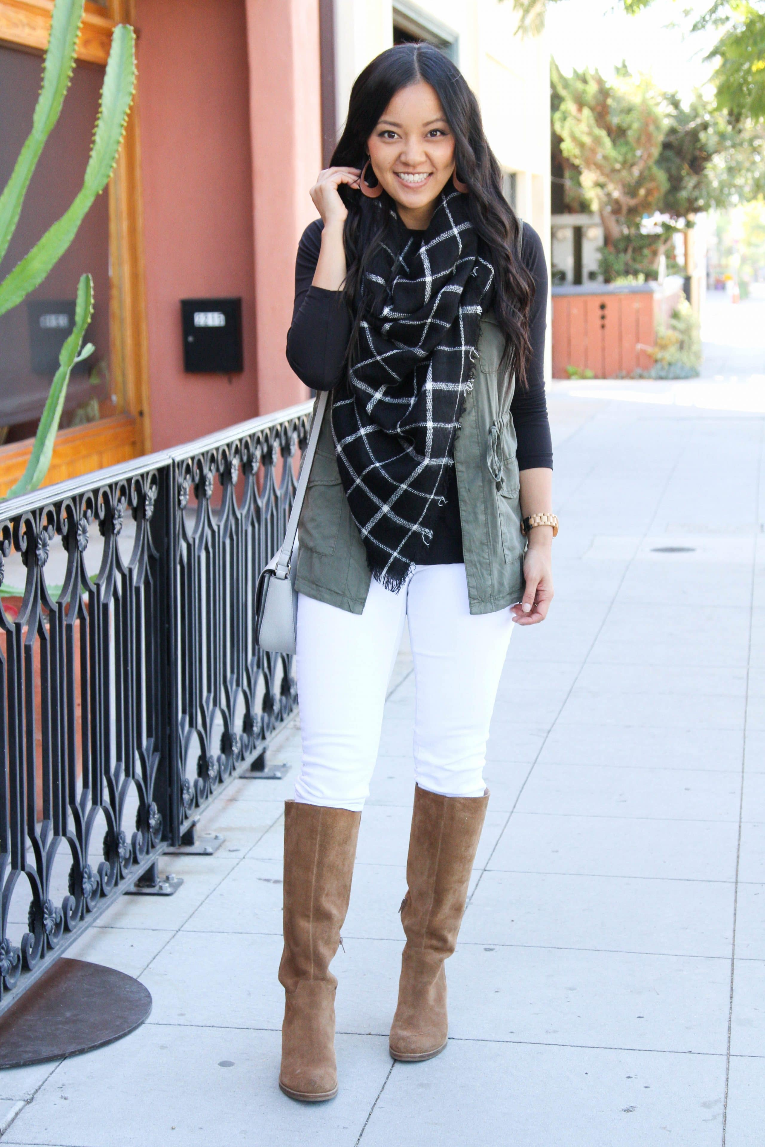 White jeans + vest + blanket scarf + boots