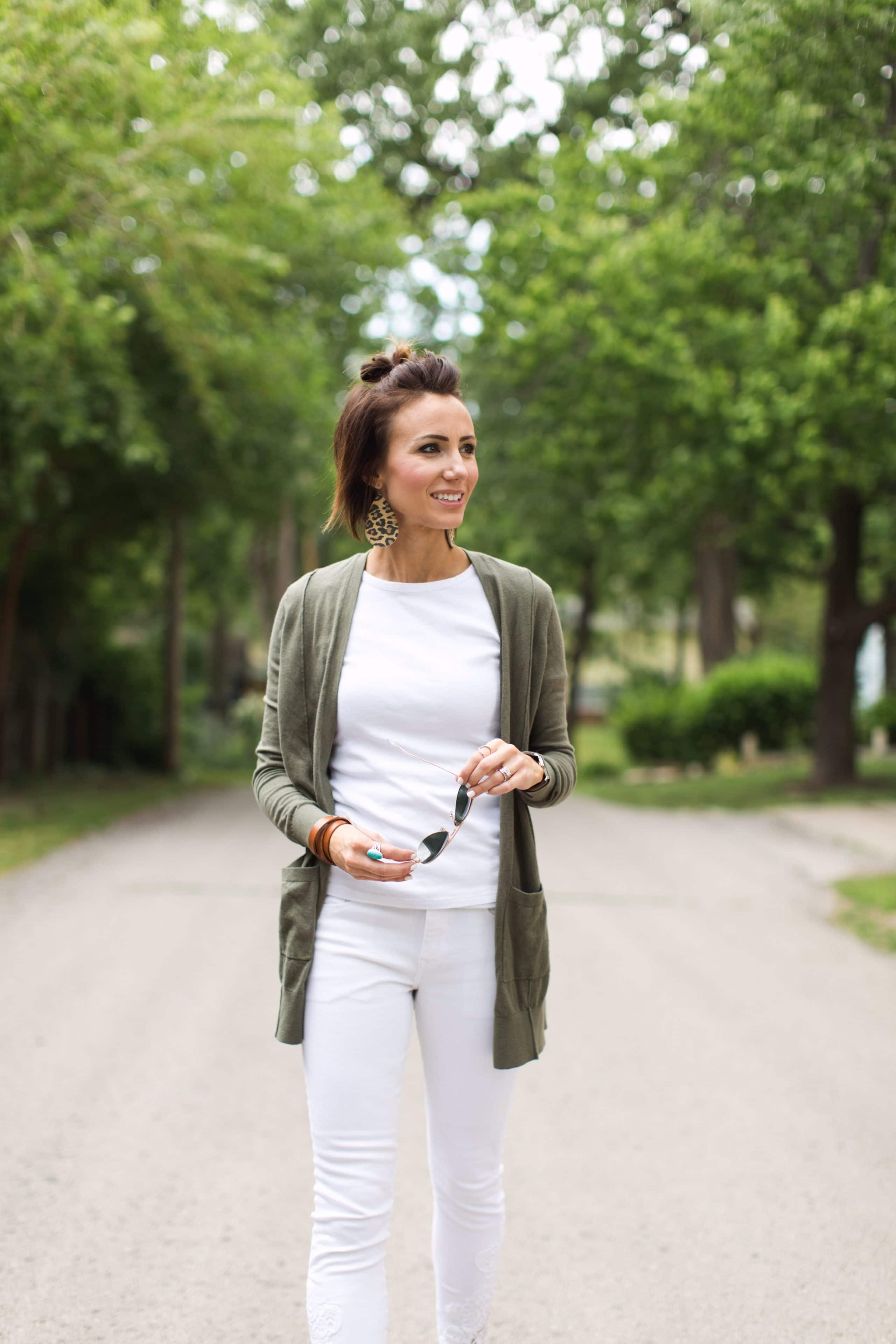 white top + white pants + olive green cardigan + leopard print earrings