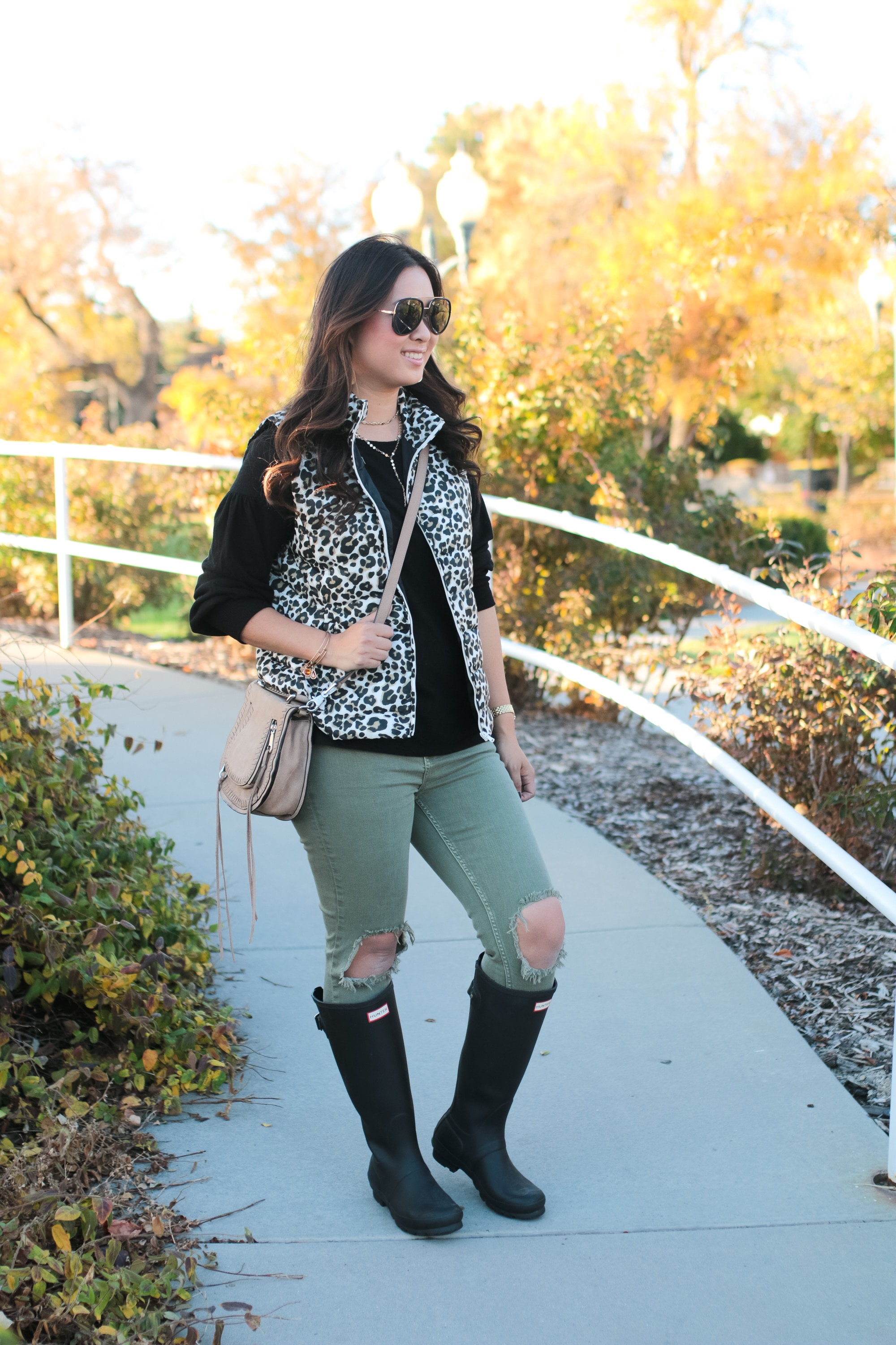 Leopard Vest + Black Top + Green Jeans + Hunter Boots