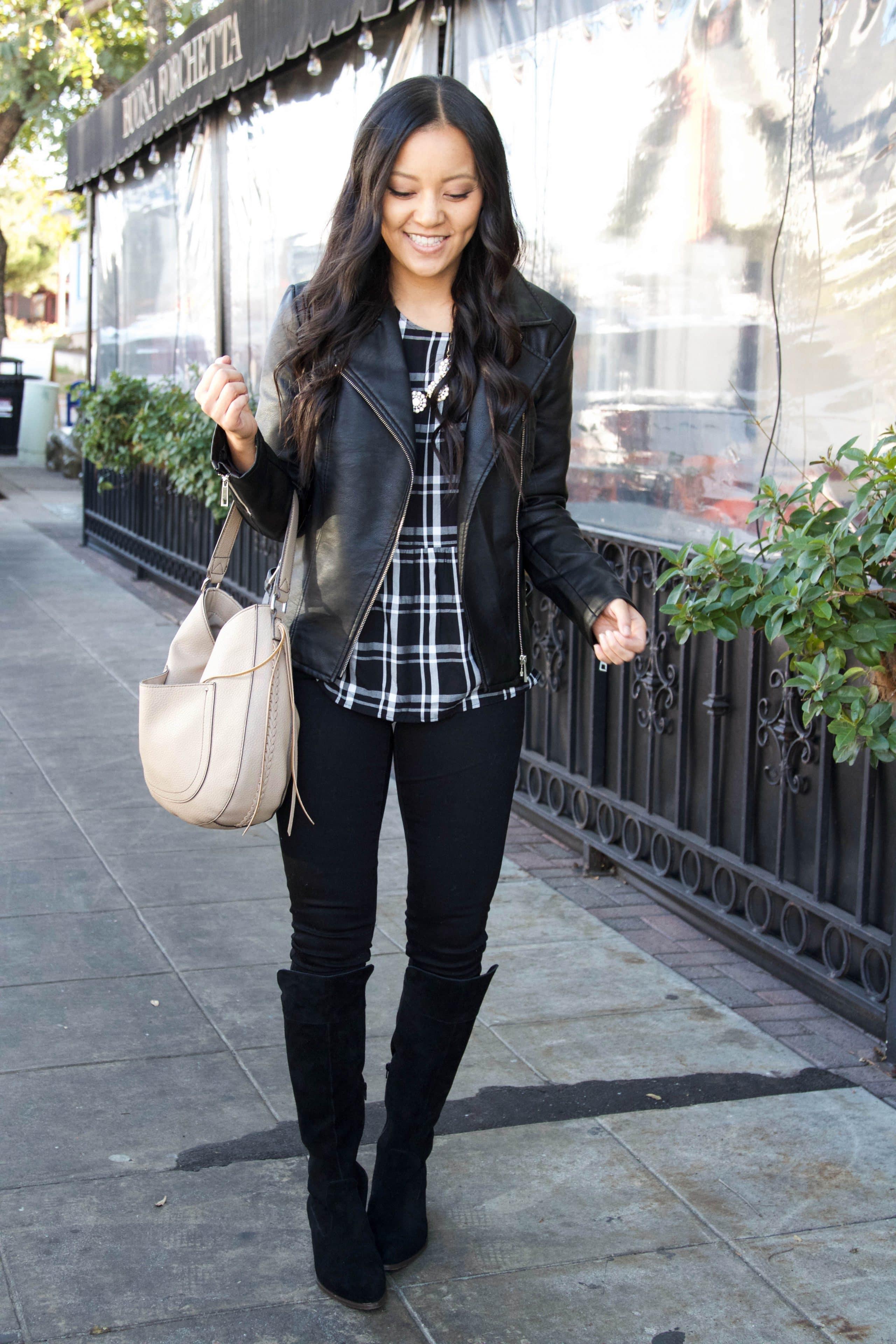 Black tall boots + tan bag + plaid top + moto jacket
