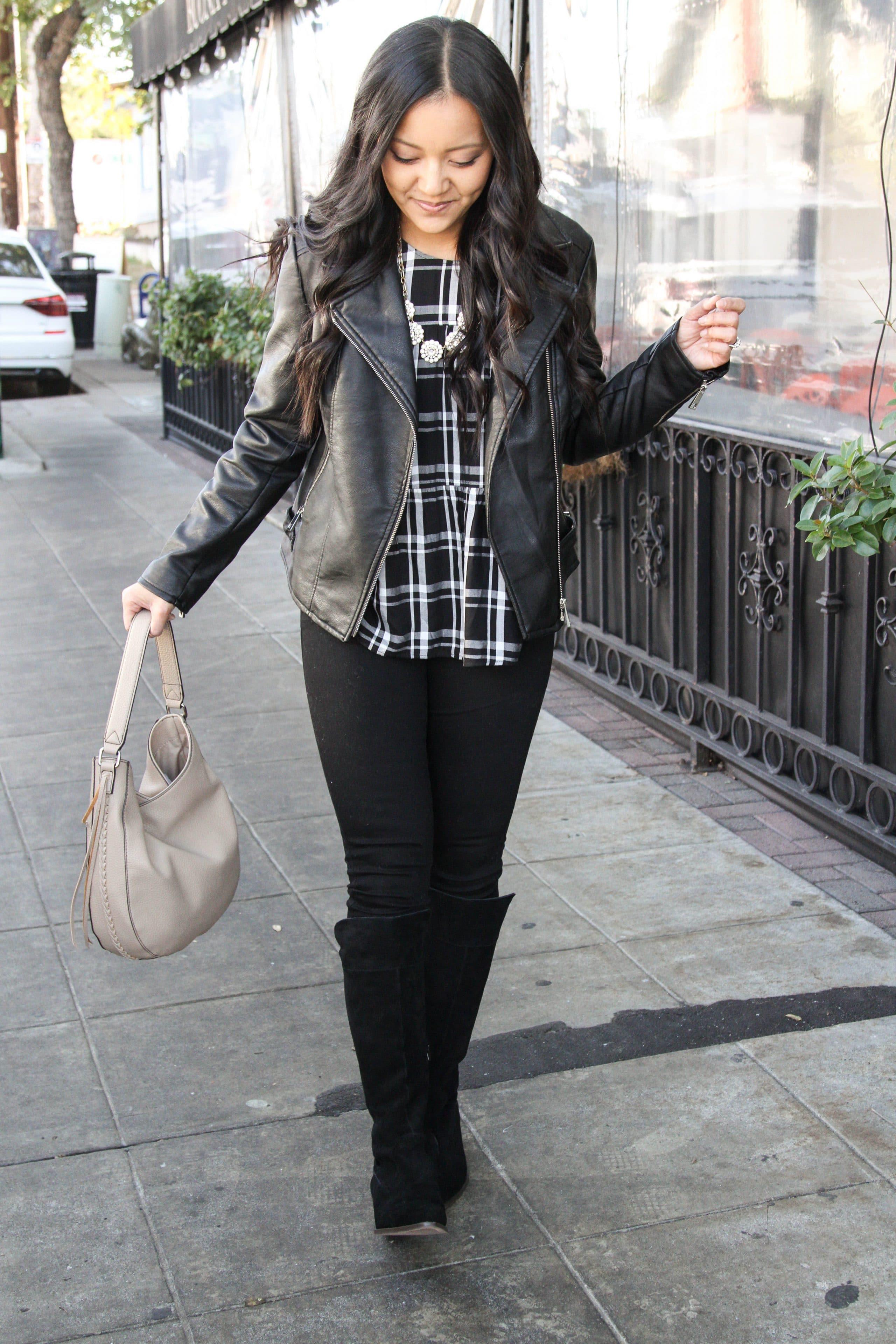 Black boots + tan bag + statement necklace + moto jacket
