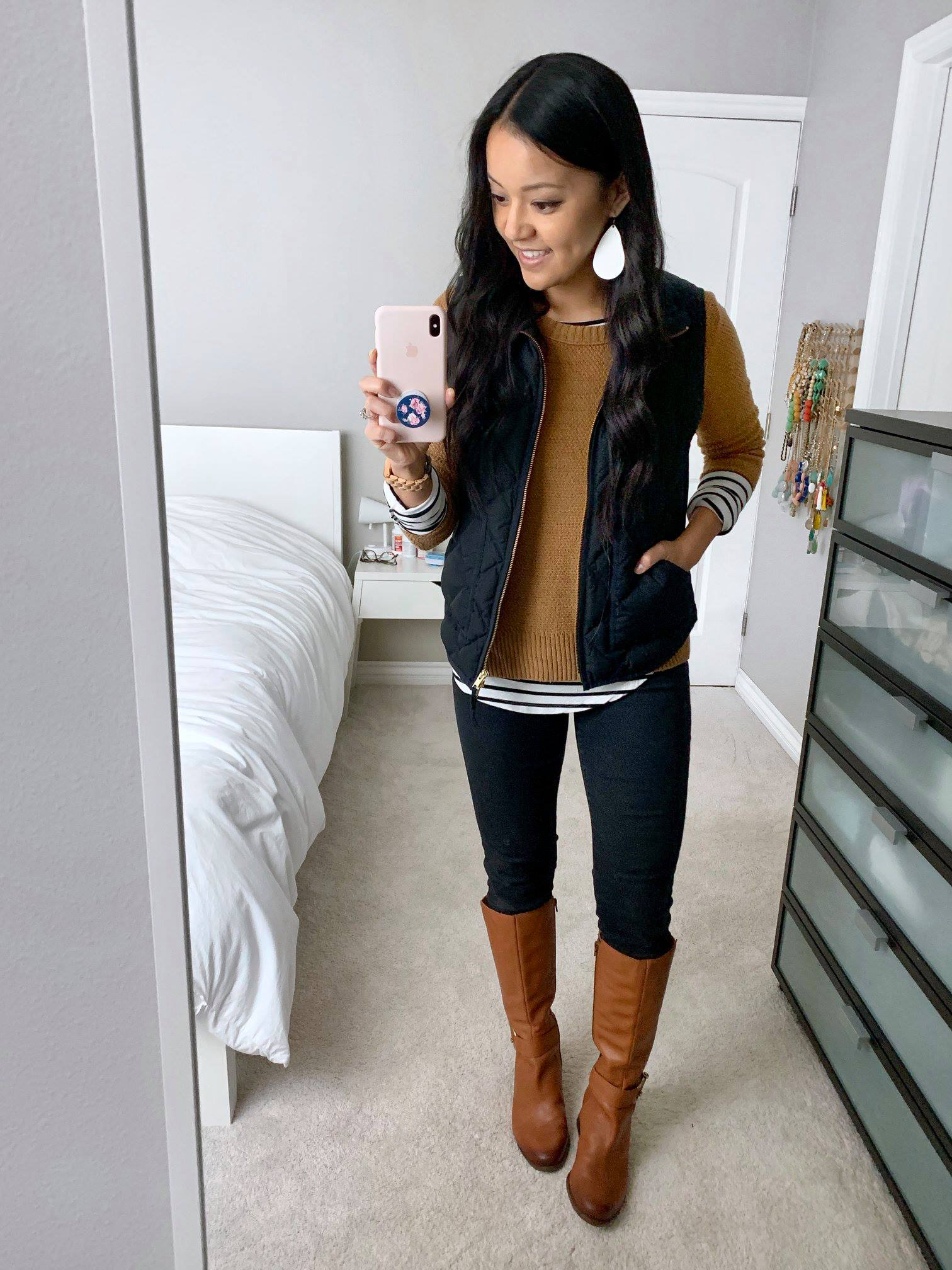 Black Vest + Camel Sweater + Striped tee + Black jeans + Boots