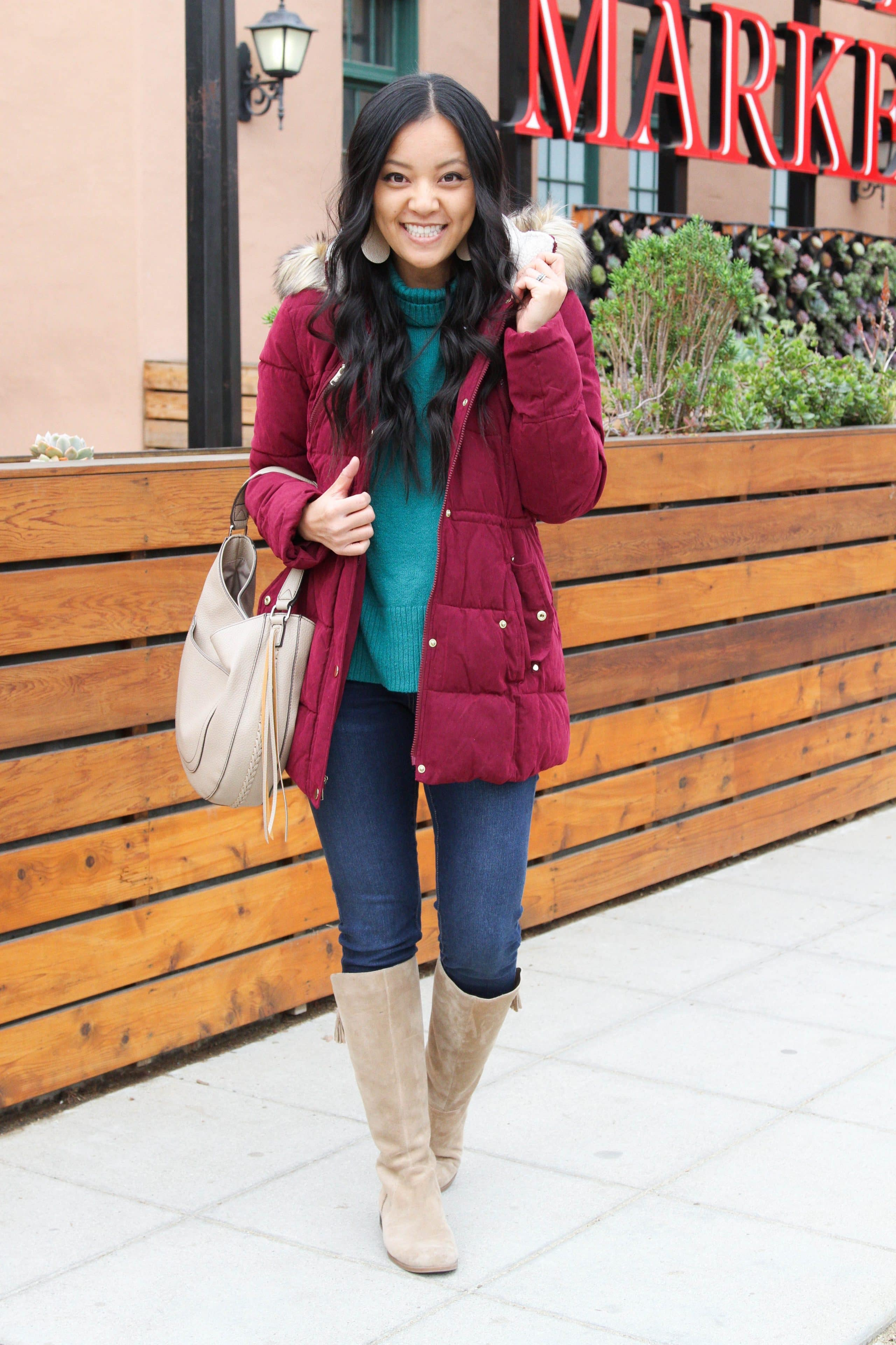 Puffer Jacket + Green Sweater + Jeans + Taupe Boots