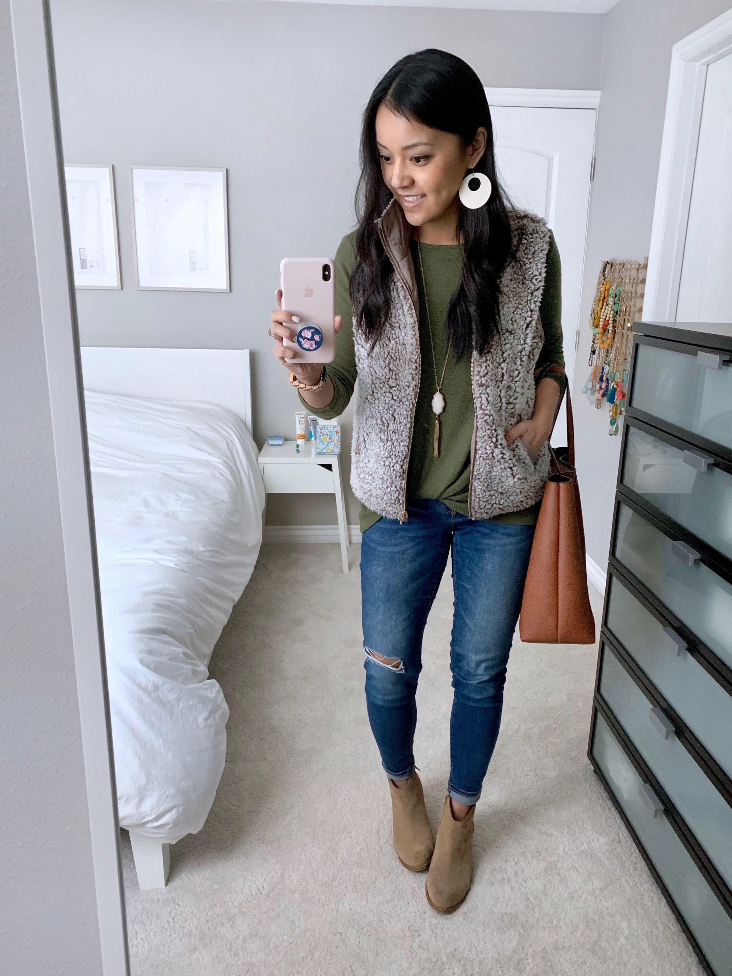 Fuzzy Vest + Olive Twist Tee + Statement Earrings + Distressed jeans + Booties