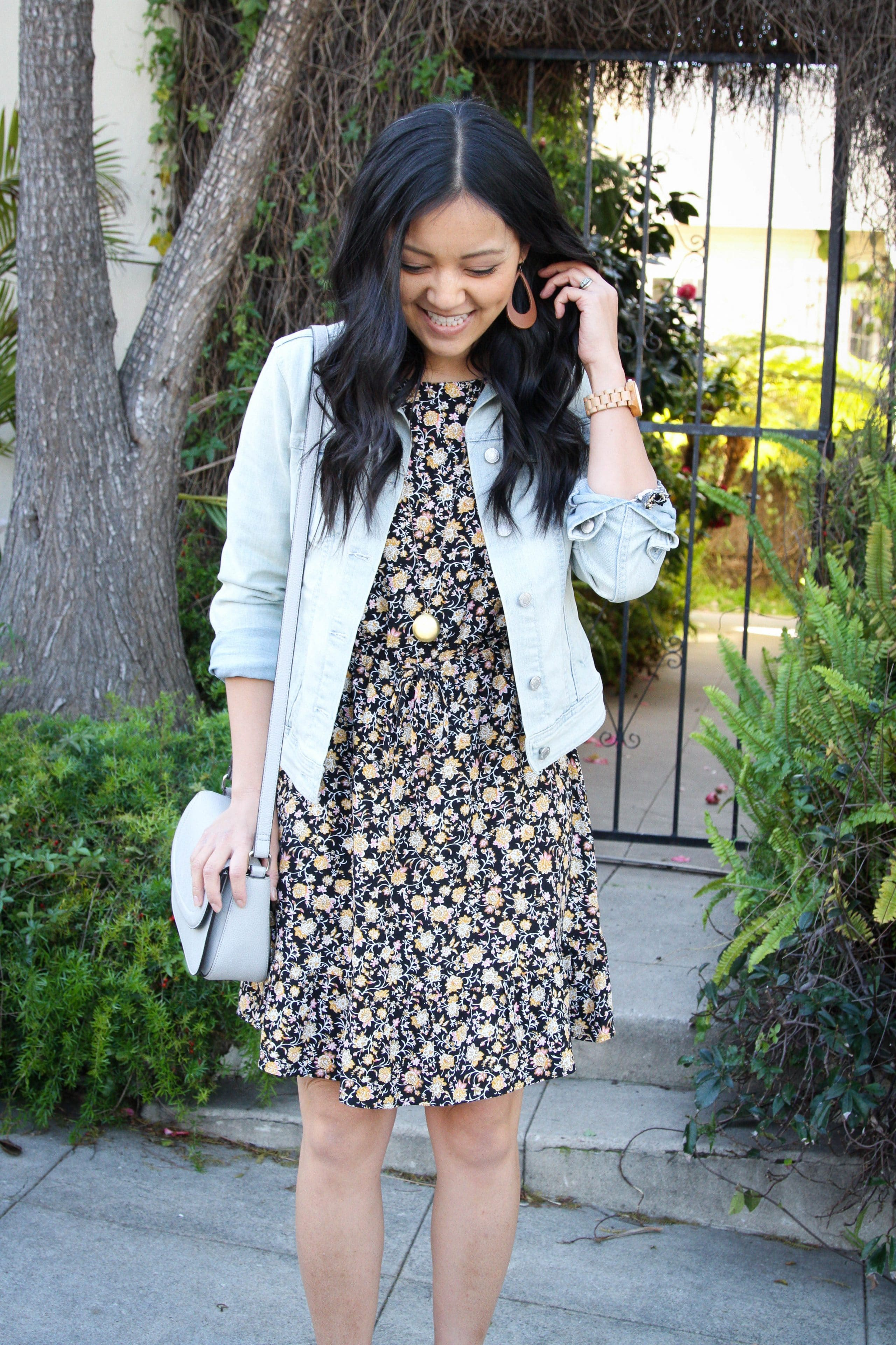 Denim Jacket + Grey Crossbody Bag + Black Floral Dress + Statement Necklace + Earrings
