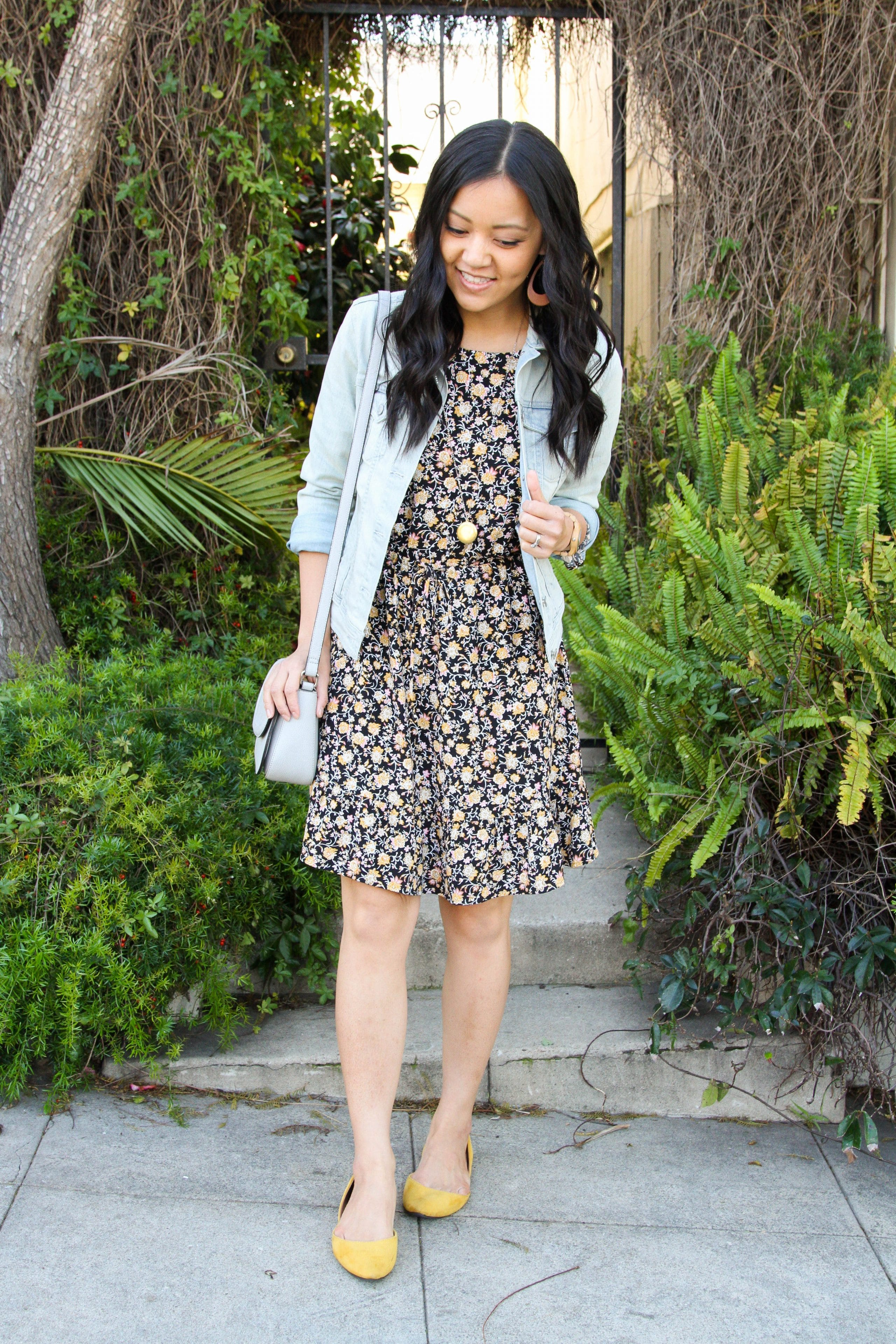 Black Floral Dress + Denim Jacket + Yellow Flats + Grey Crossbody Bag