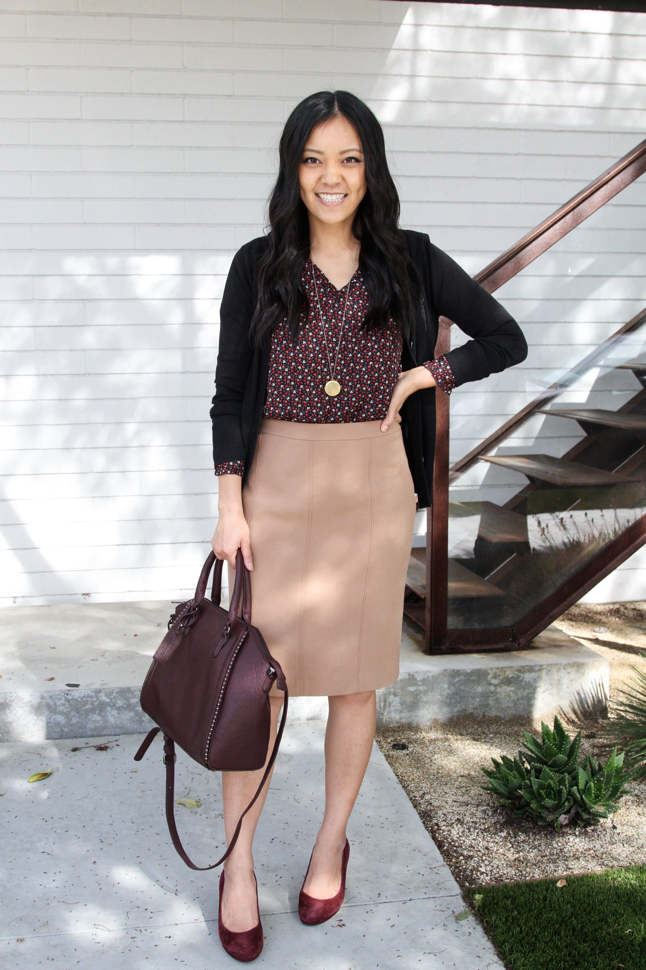 Business Casual: Tan Pencil Skirt + Floral Blouse + Black Cardigan + Pumps + Gold Necklace