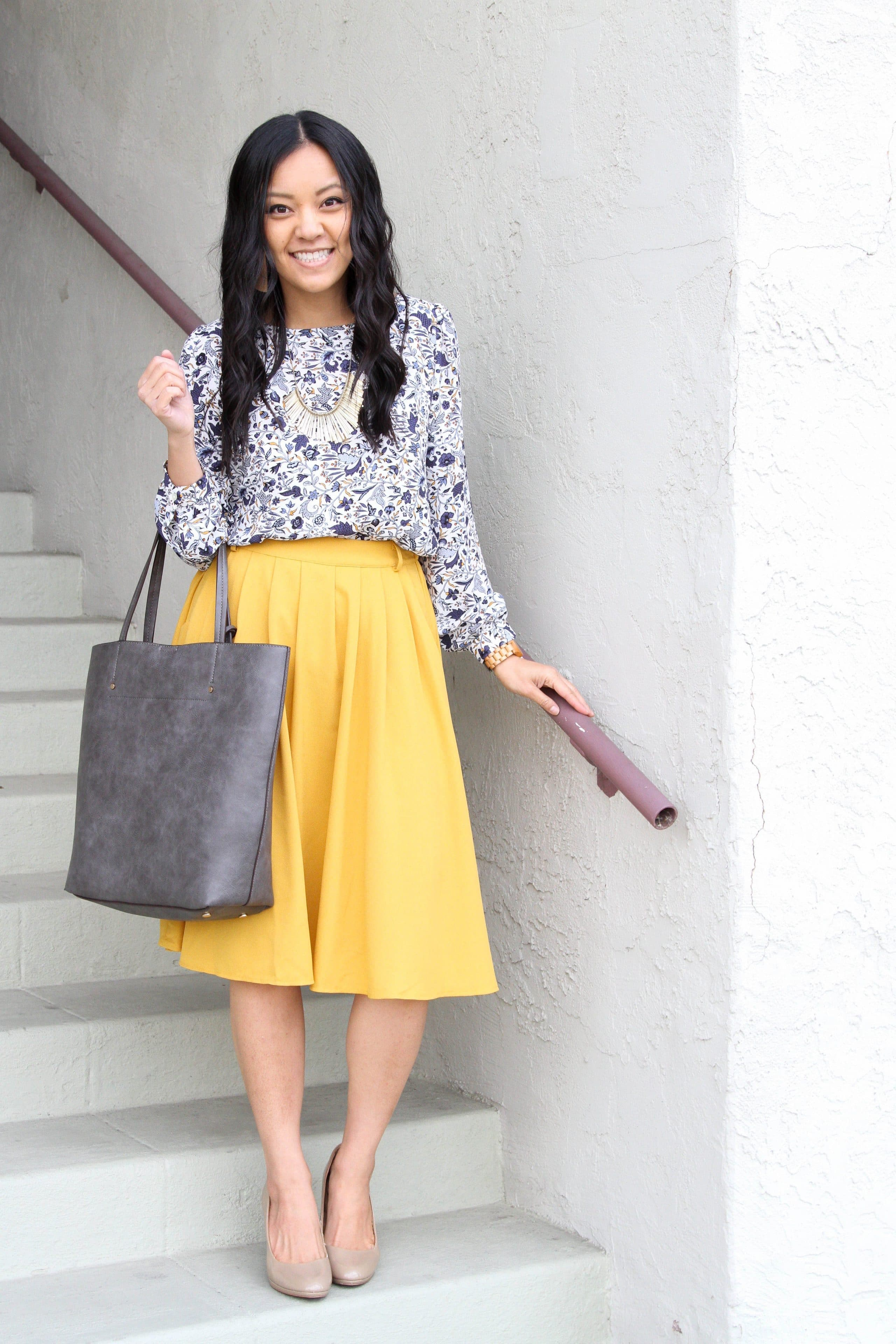 business casual outfit + white floral top + yellow skirt + nude pumps + grey tote + statement necklace