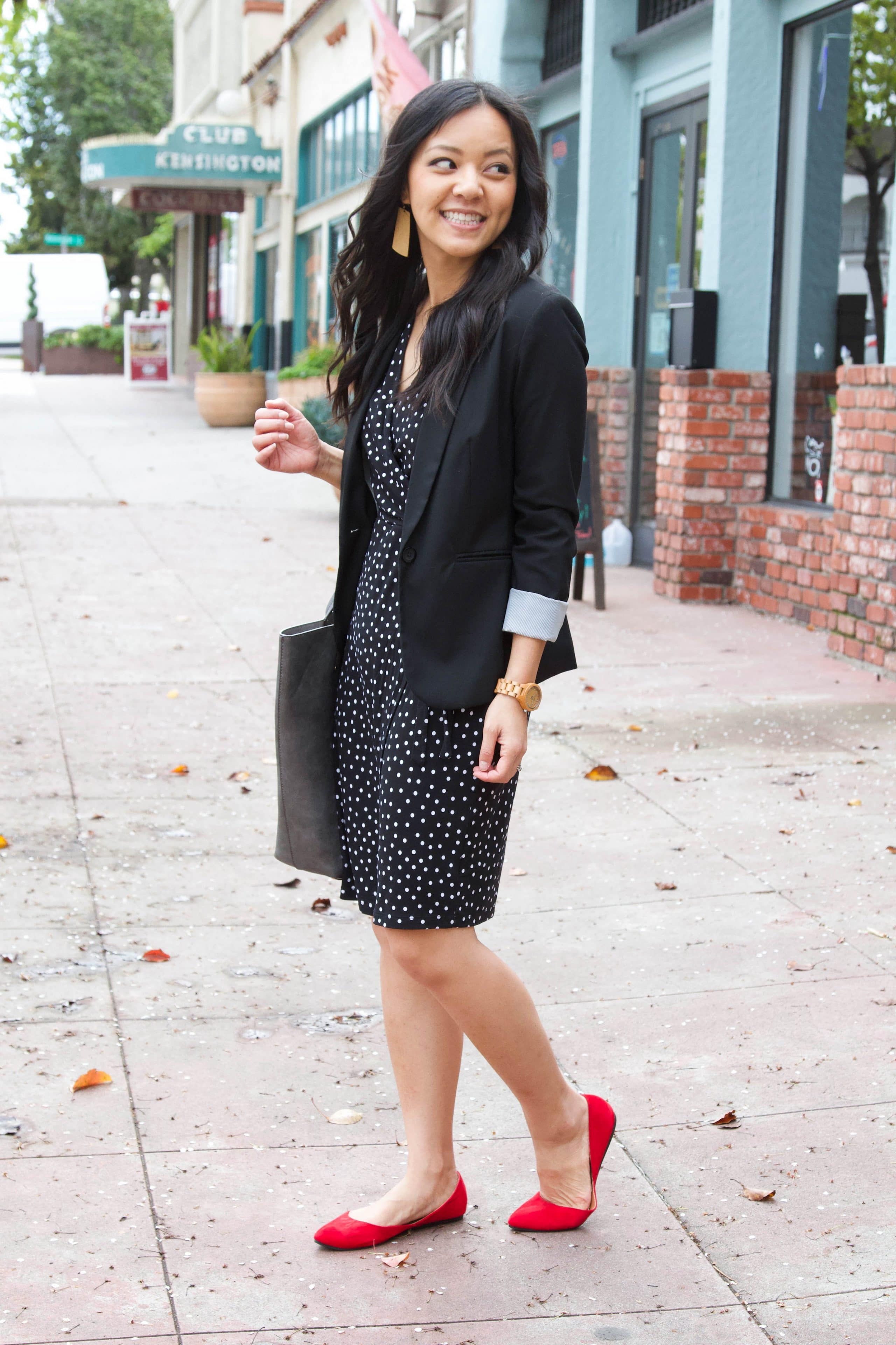business casual outfit + wooden watch + black polka dot dress + red flats + brown earrings