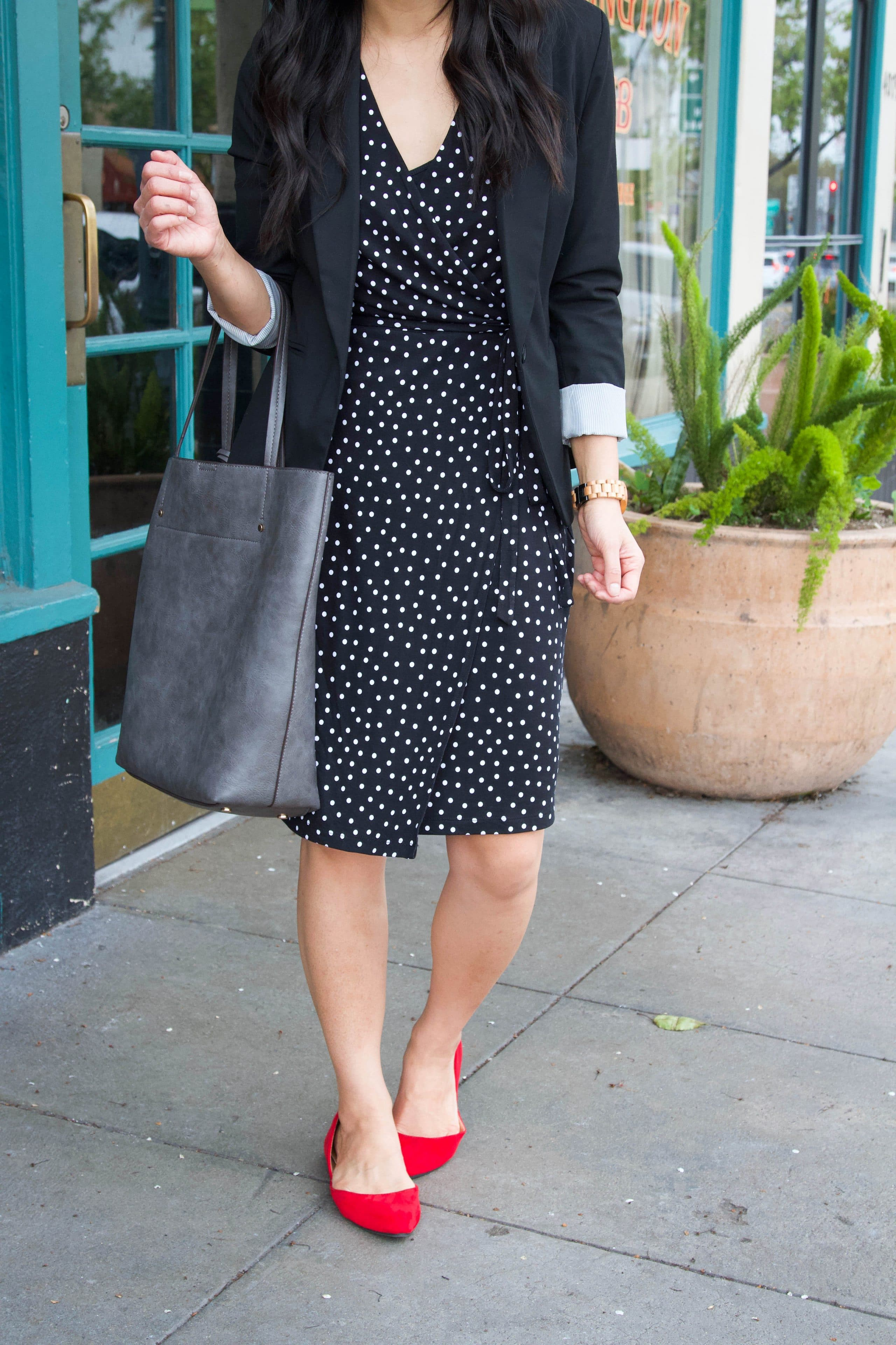 business casual outfit + black polka dot dress + red flats + grey tote + black blazer