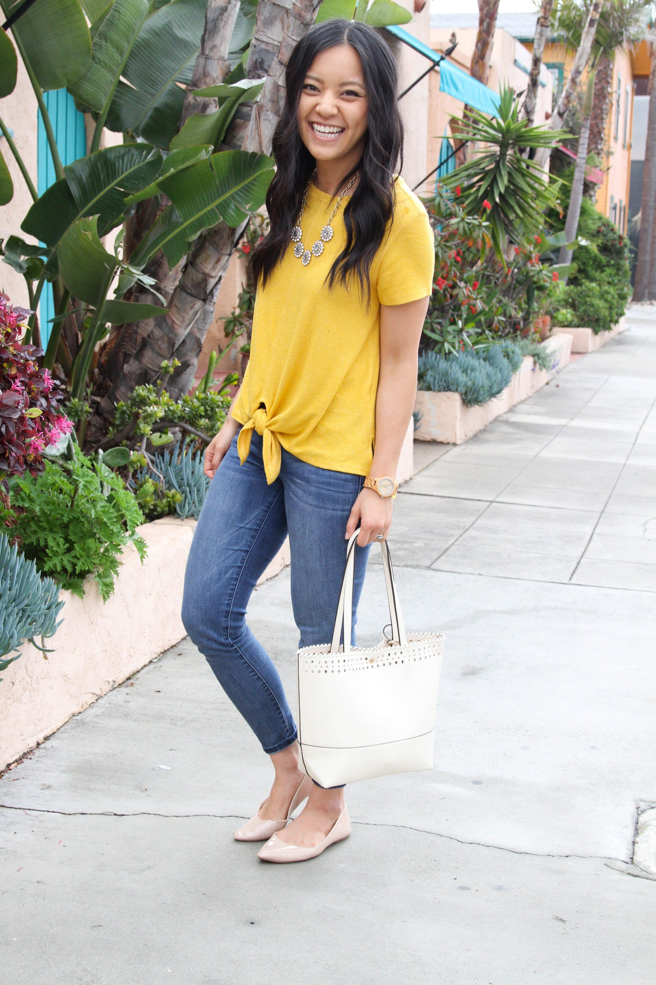 Yellow tie top + Light jeans + blush flats + white tote + statement necklace