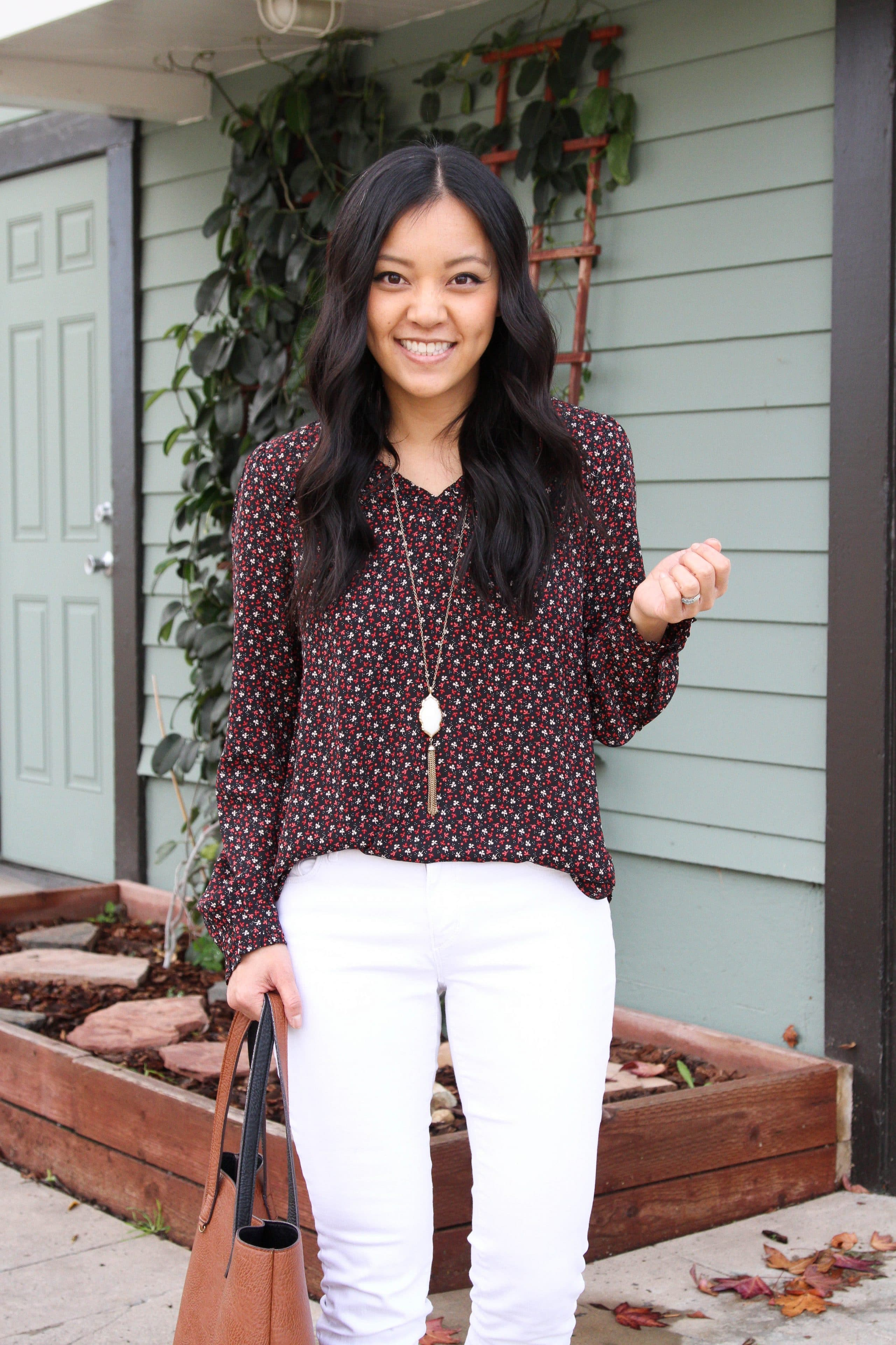 Red and black floral top + white skinnies + white necklace + brown tote