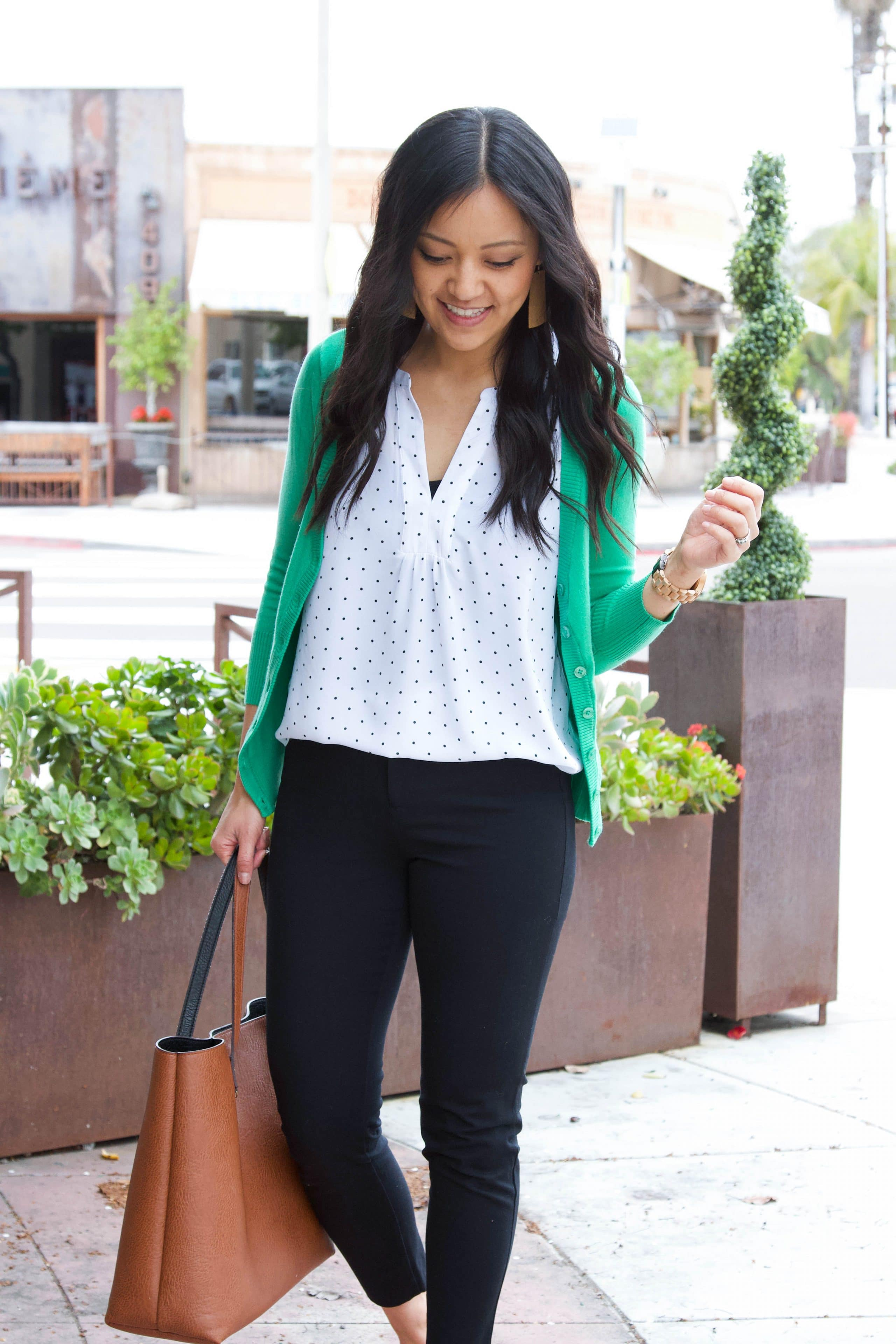 business casual outfit + white polka dot shirt, + green cardigan + black ankle pants + cognac tote
