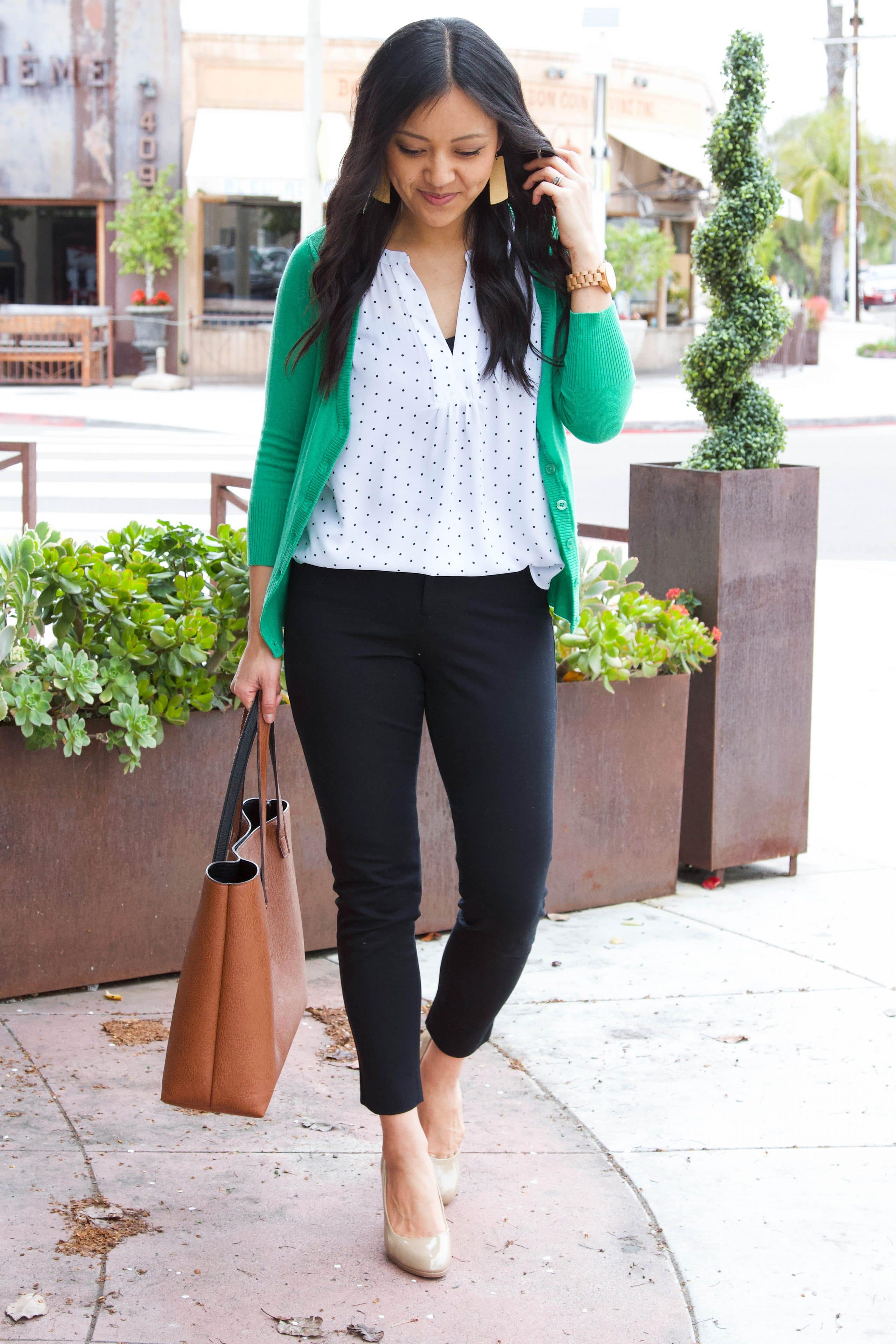 business casual outfit + white polka dot shirt + green sweater + black ankle pants + nude pumps + cognac tote