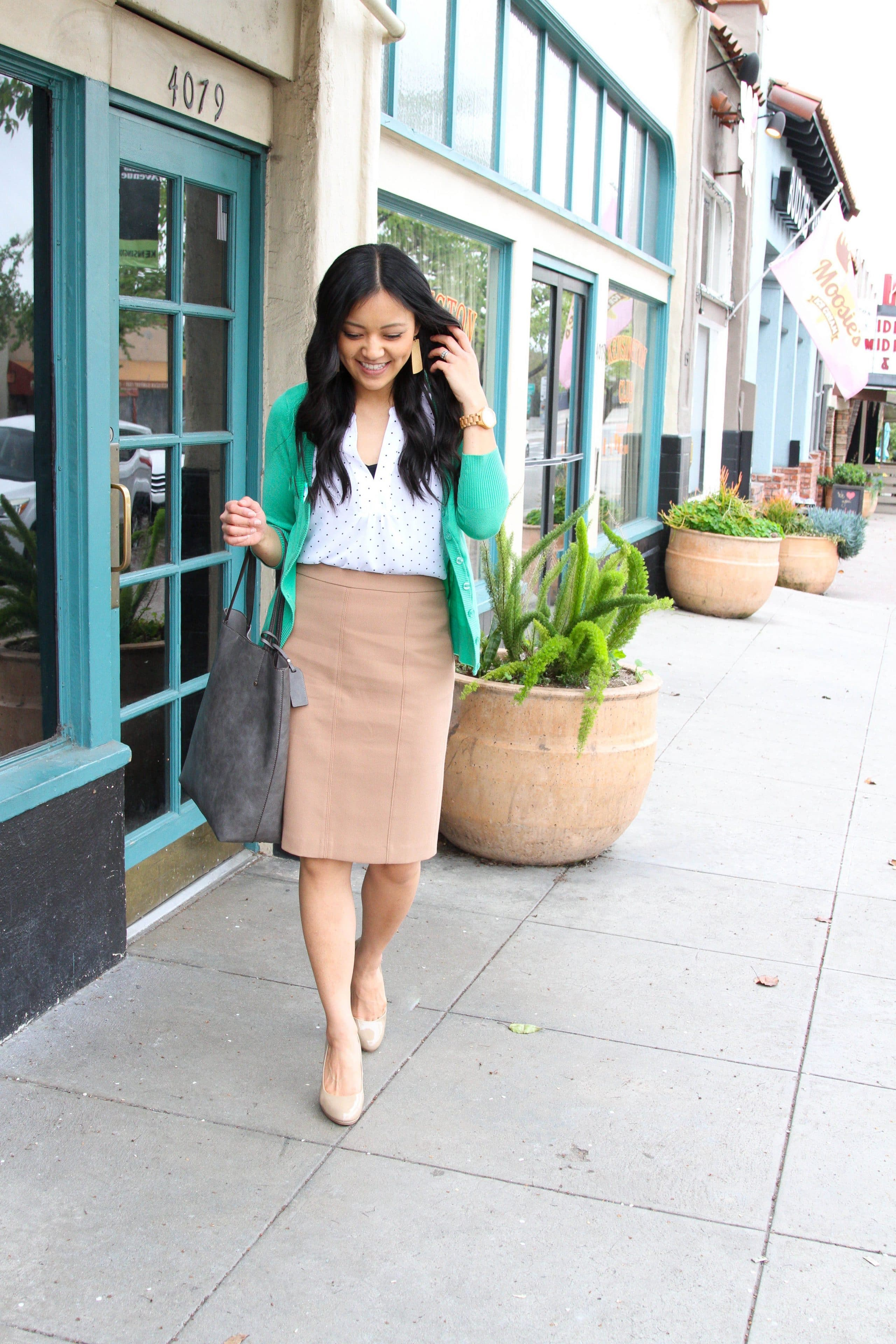 business casual outfit + green cardigan + white blouse + grey tote + statement earrings + nude pumps