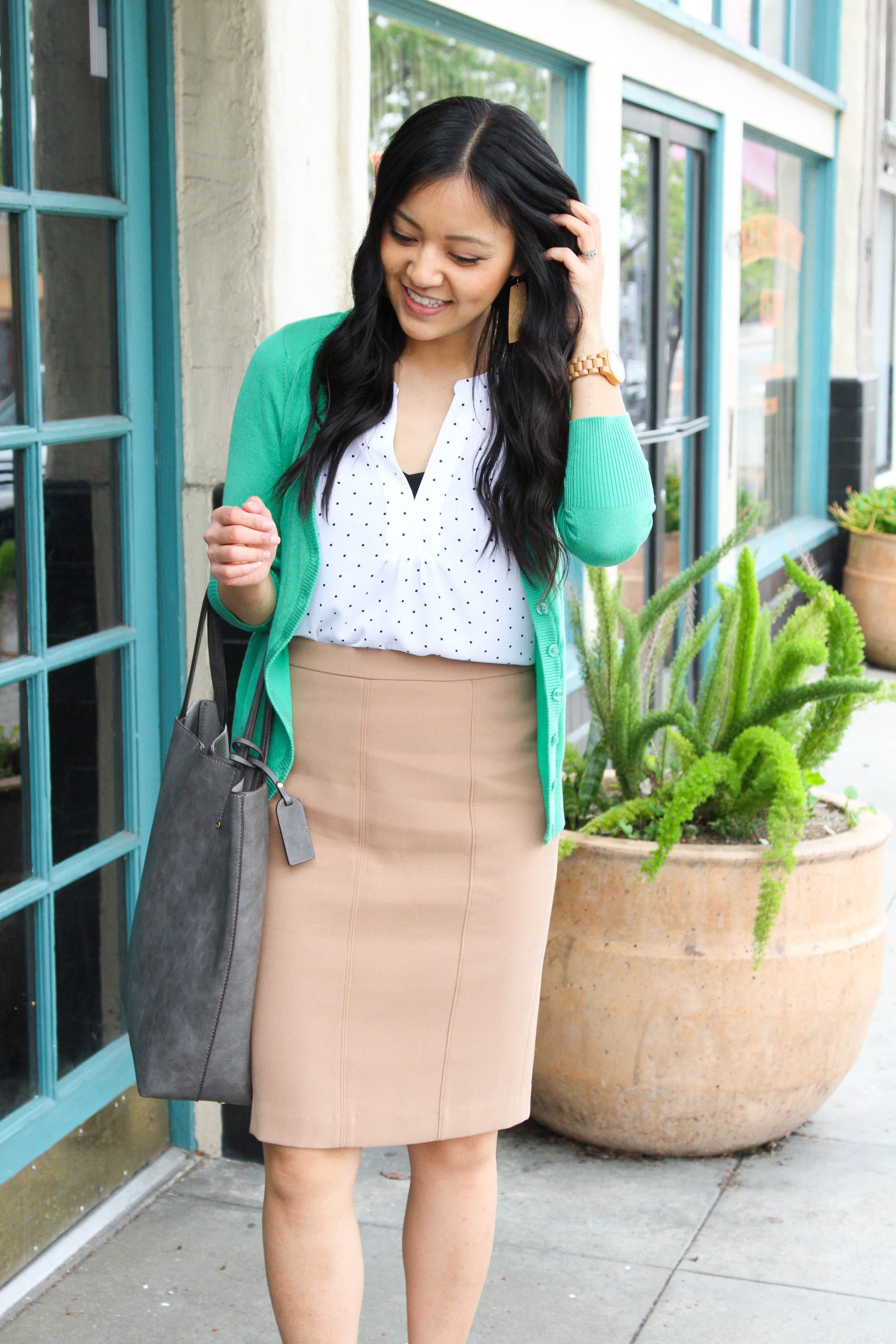 business casual outfit + white polka dot shirt + tan skirt + green cardigan + grey tote