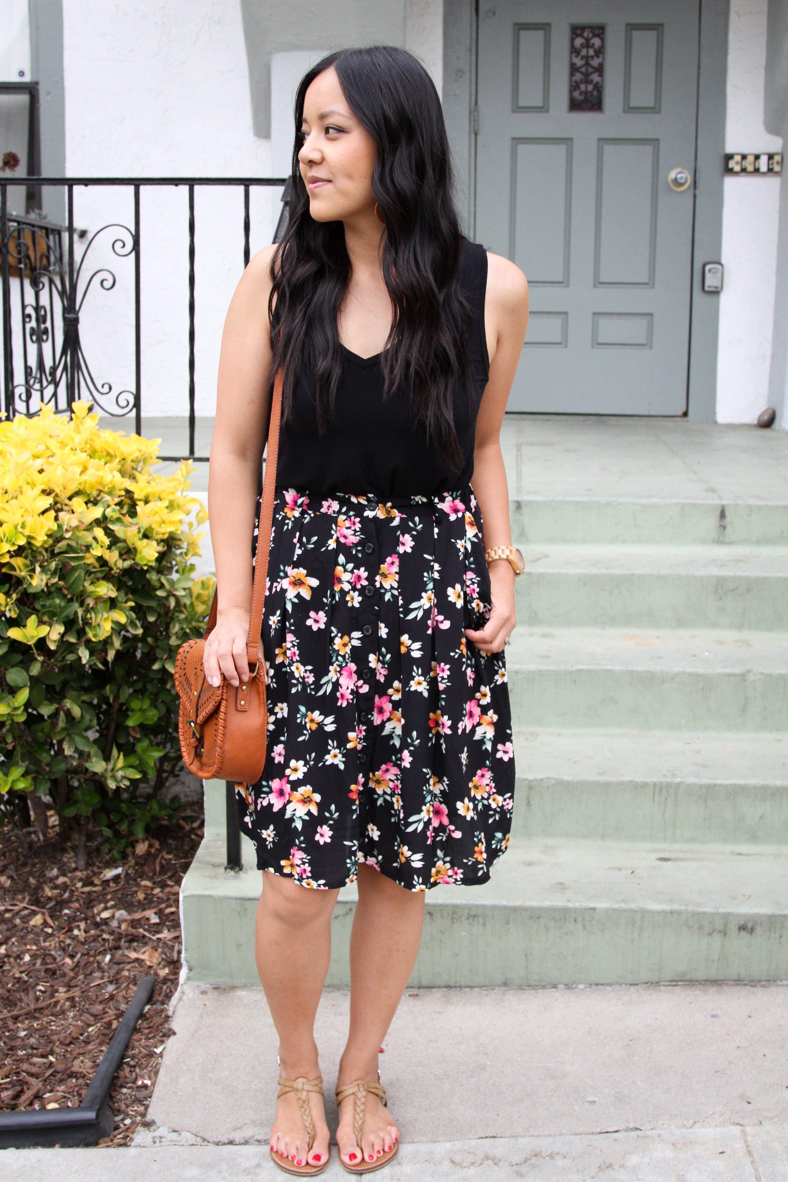 black floral skirt + black top + cognac purse + tan sandals