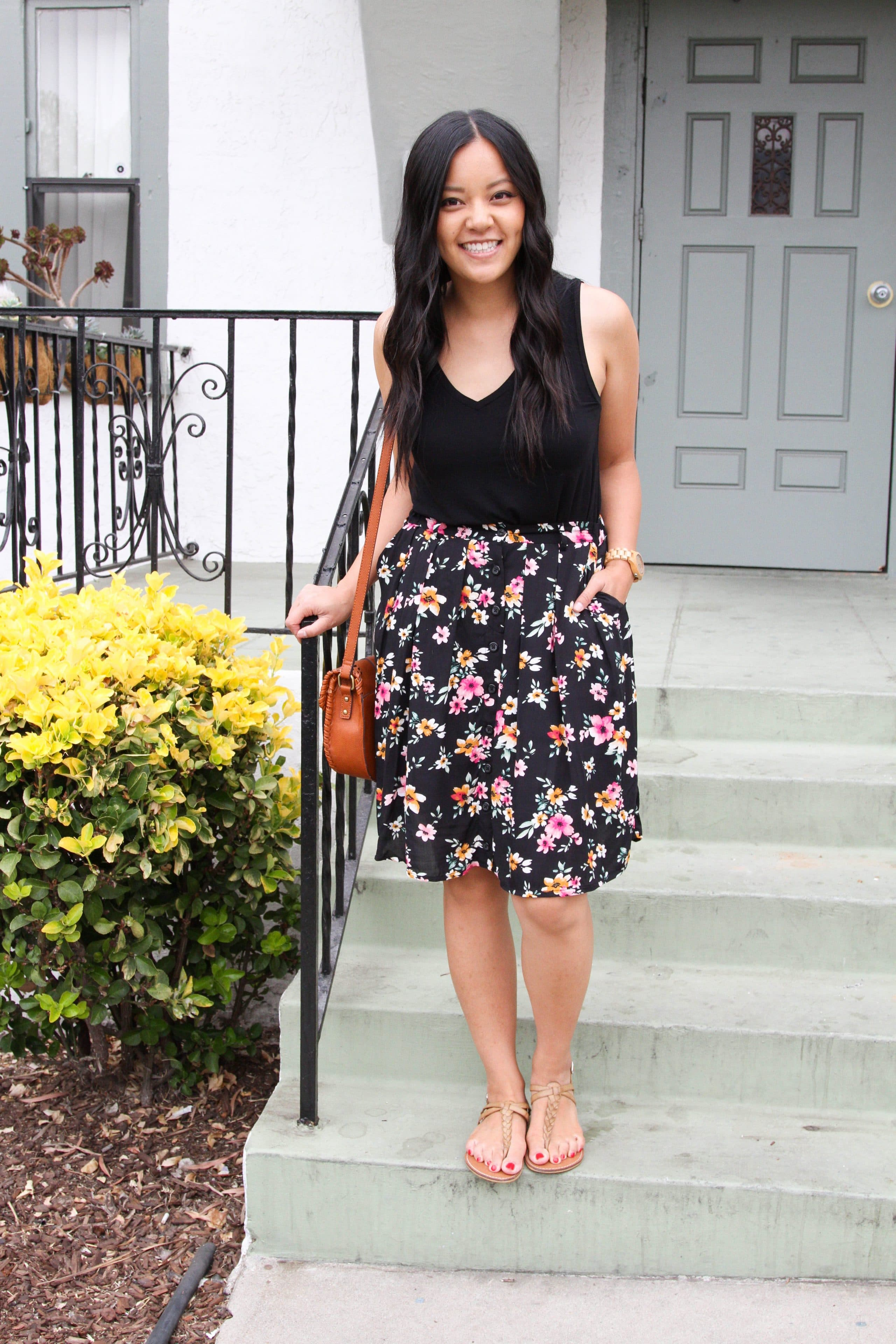 black floral skirt + cognac purse + tan sandals + black top