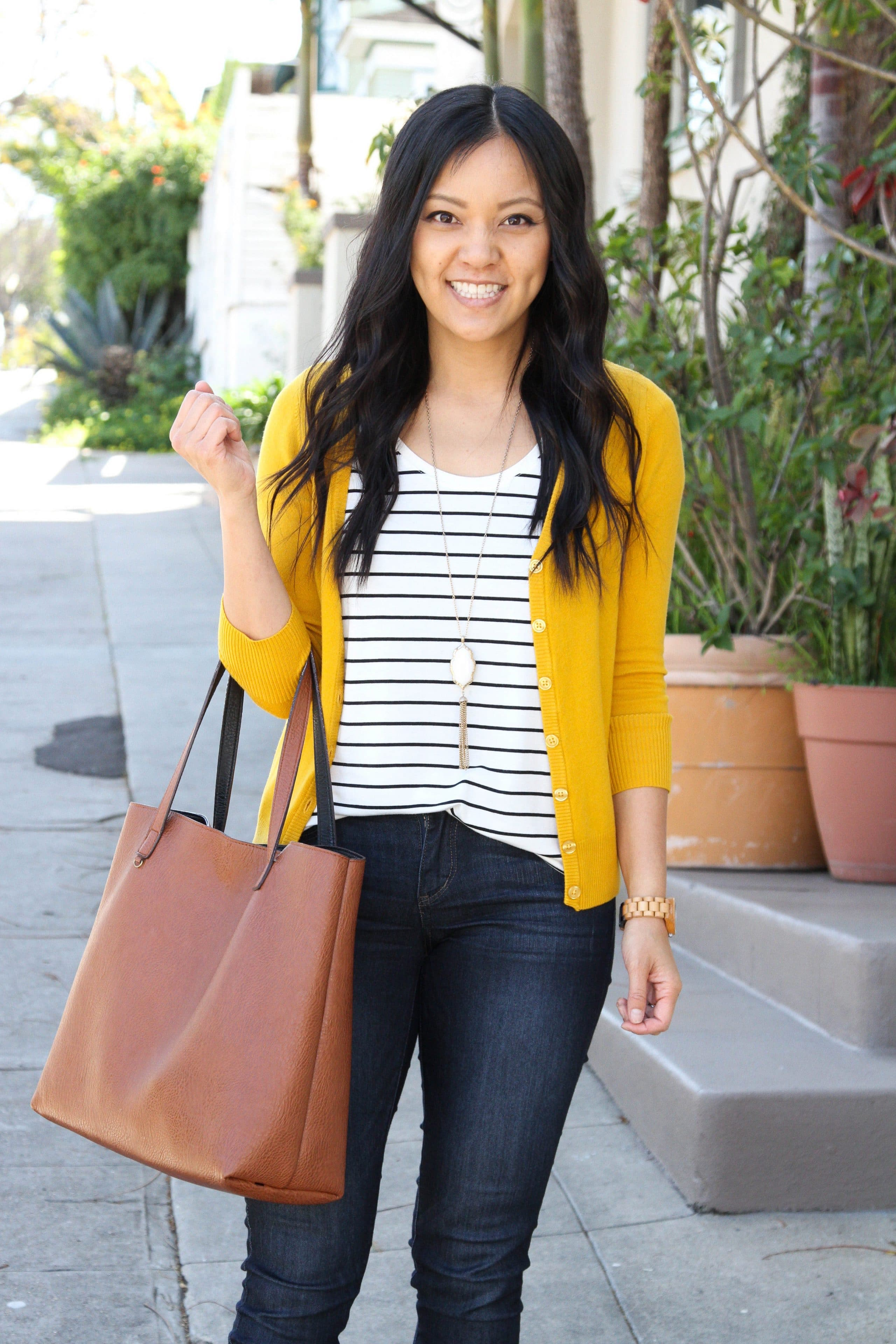 yellow cardigan + striped tee + skinny jeans + brown tote