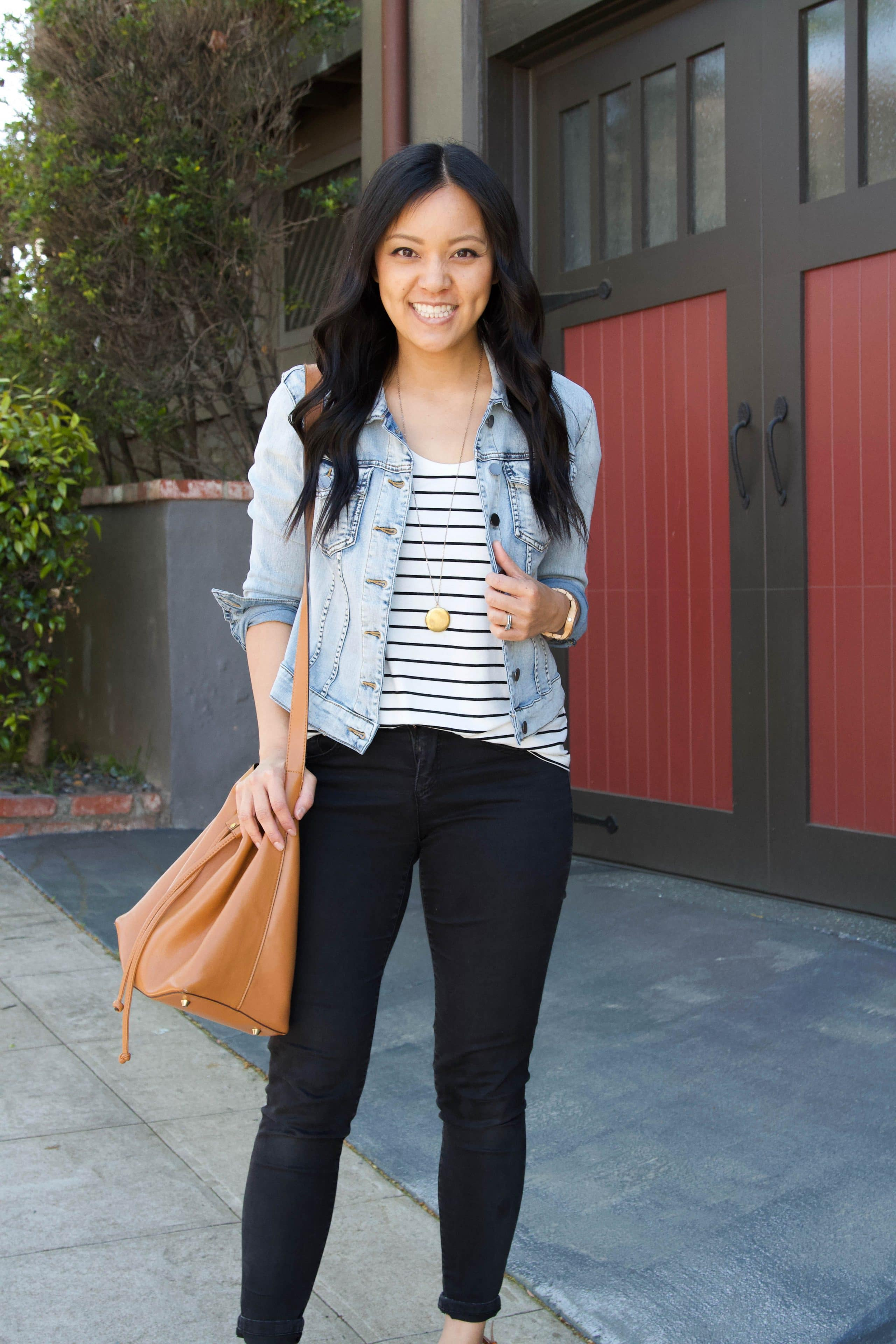 striped tee + denim jacket + black jeans + brown tote