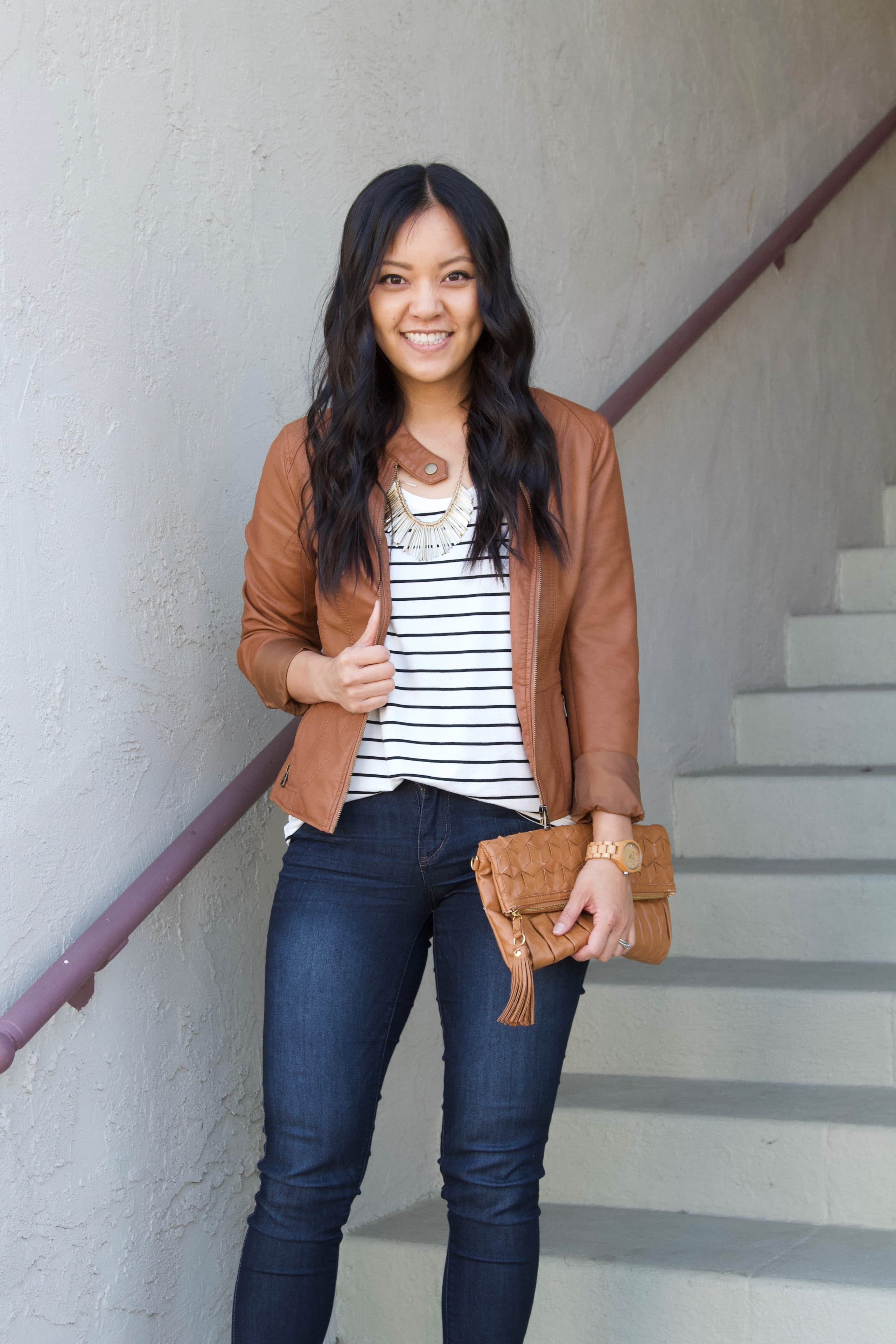 brown leather jacket + skinny jeans + striped tee