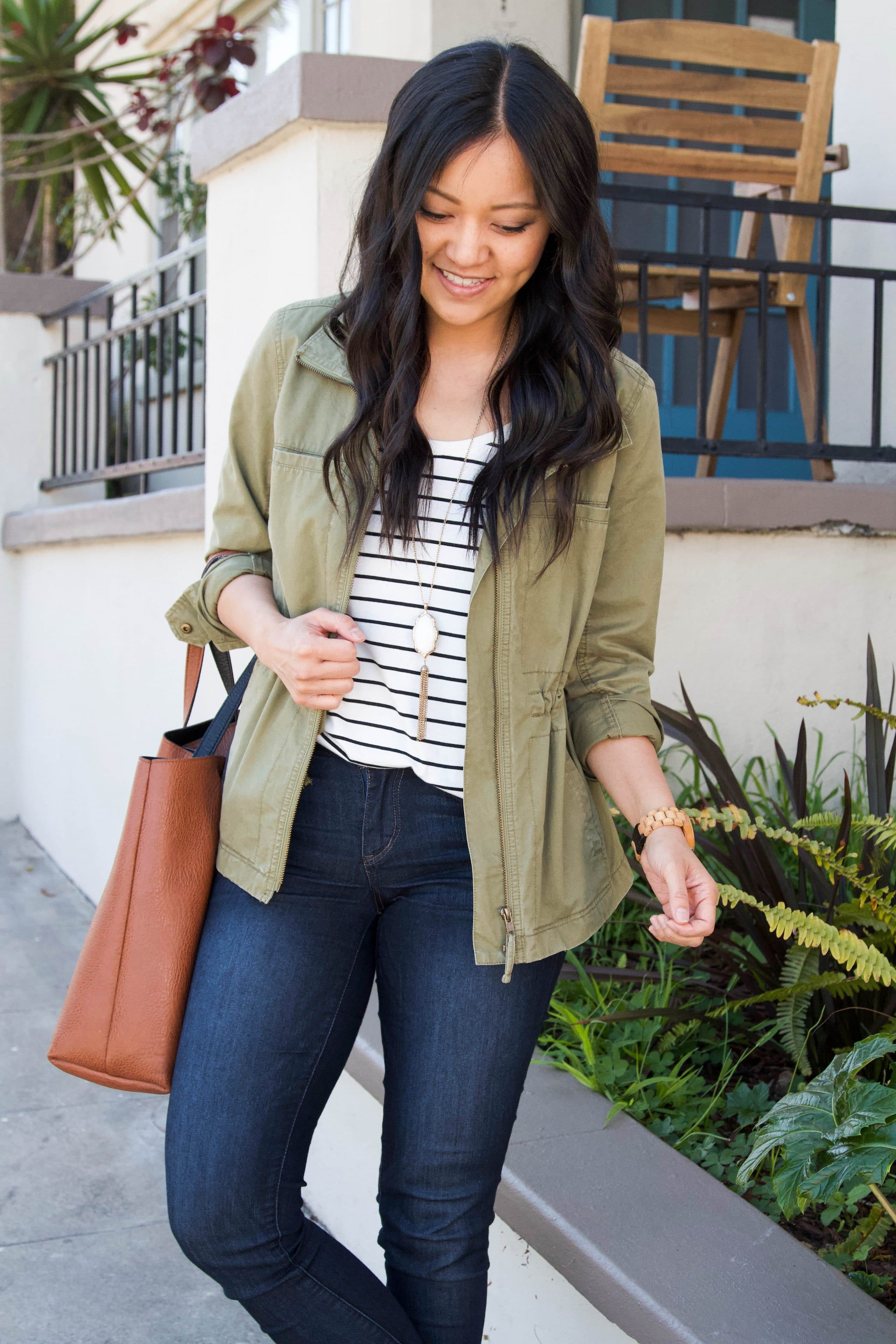 striped tee + skinny jeans + olive utility jacket + brown tote