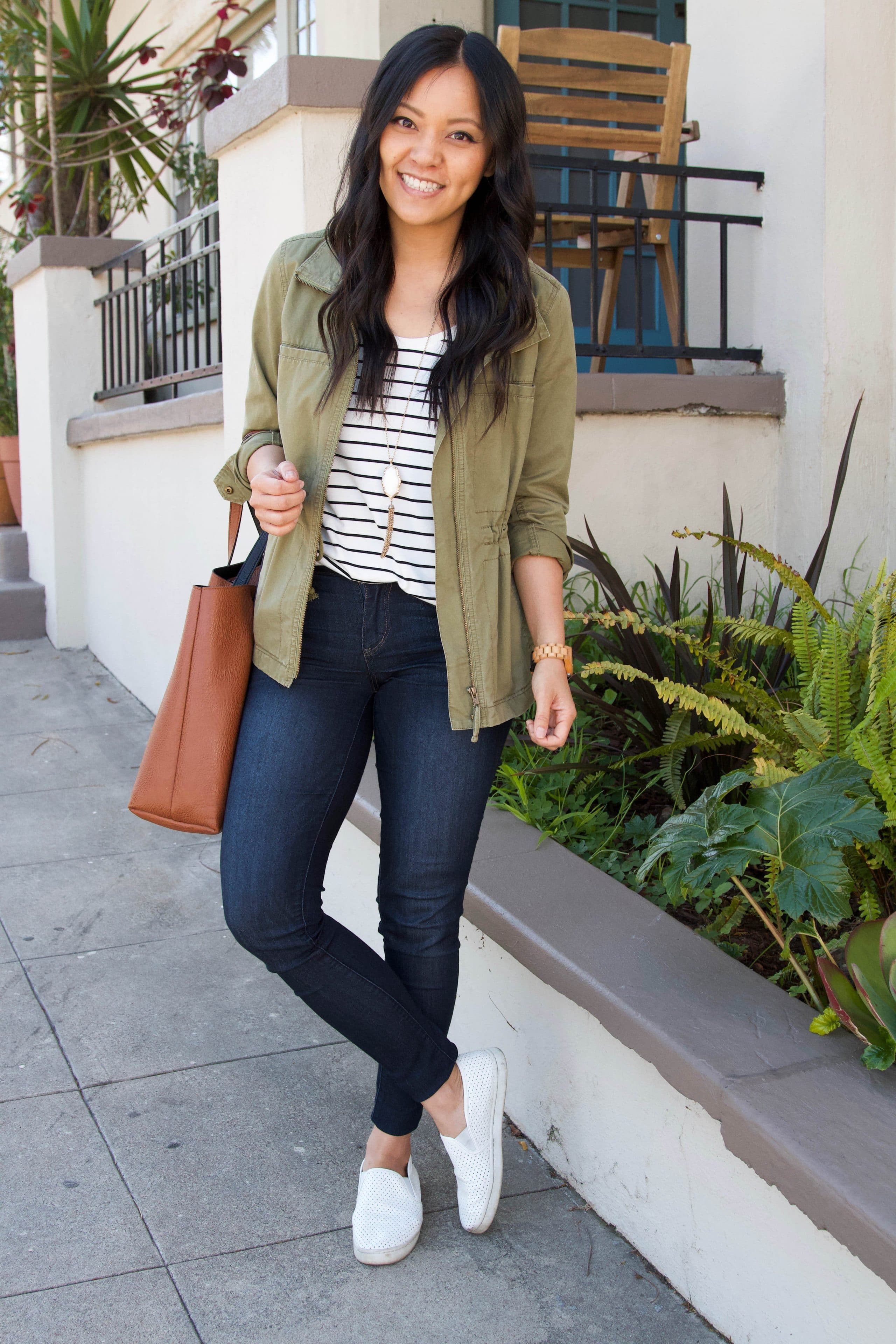 olive utility jacket + striped tee + jean jacket + white sneakers + brown tote