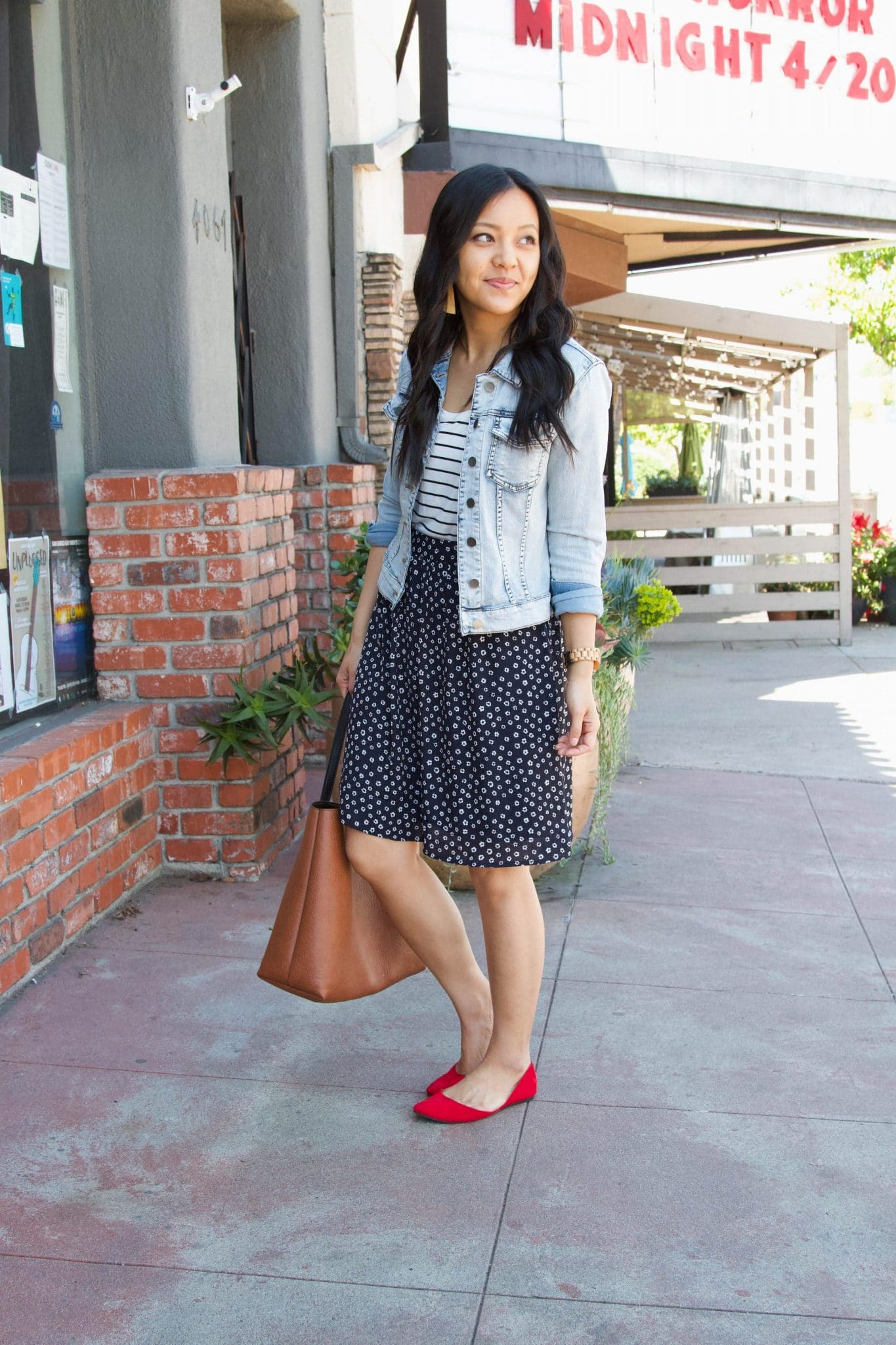 Spring Skirt Outfit: striped tee + denim jacket + navy printed skirt + red flats + cognac tote + tan leather earrings