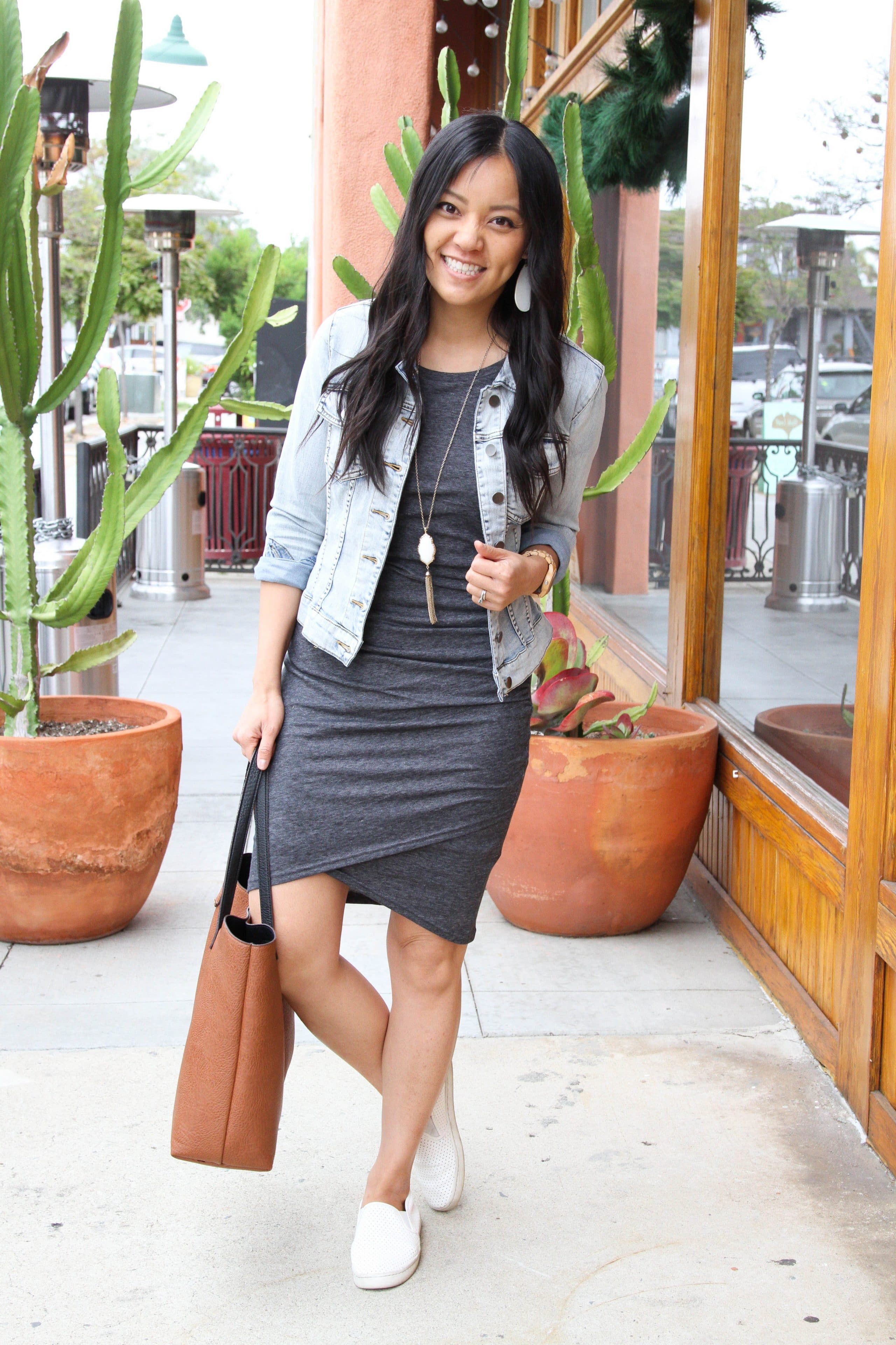 grey ruched dress+ white sneakers + denim jacket + pendant necklace + cognac tote