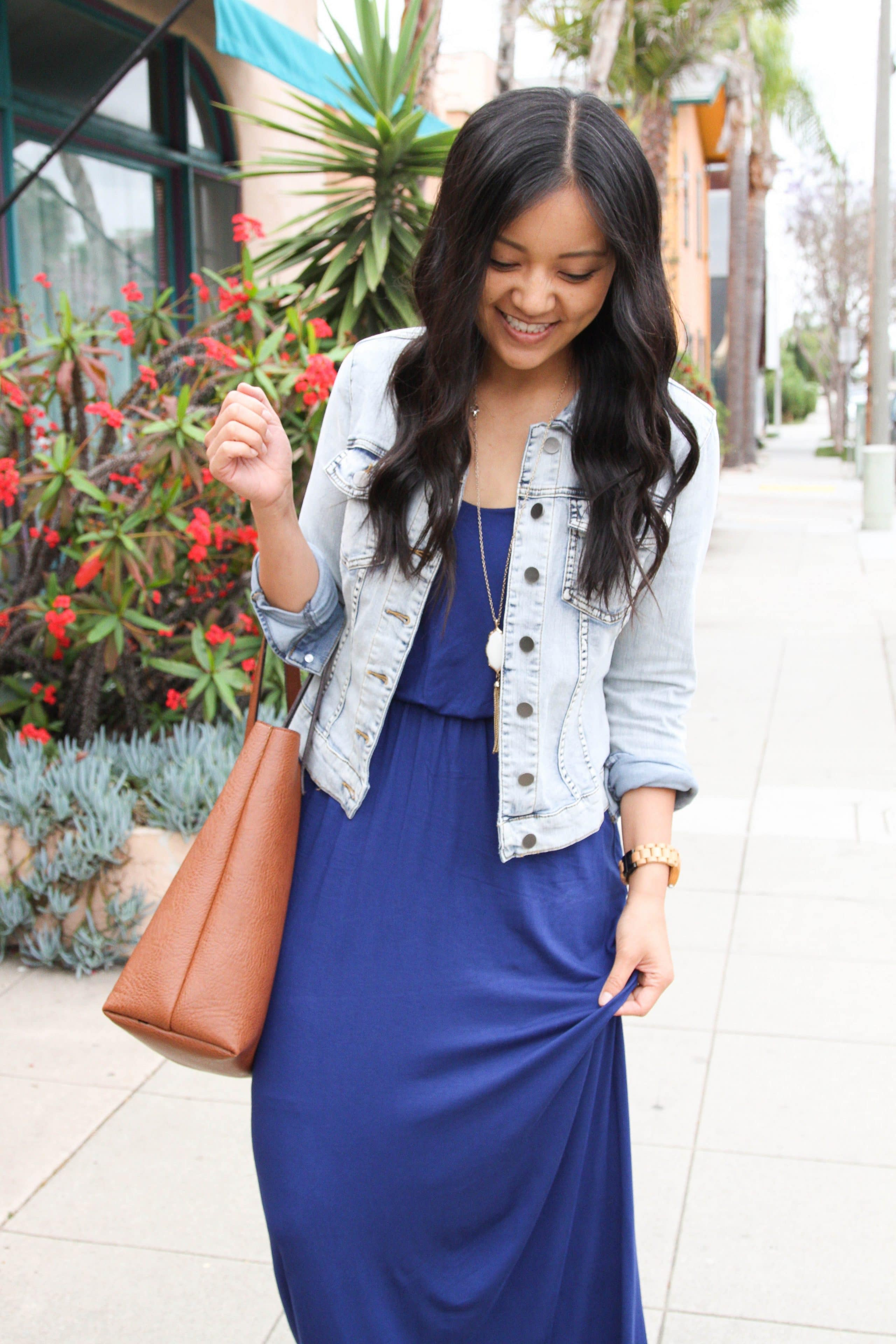 denim jacket + brown tote + blue maxi dress + pendant necklace