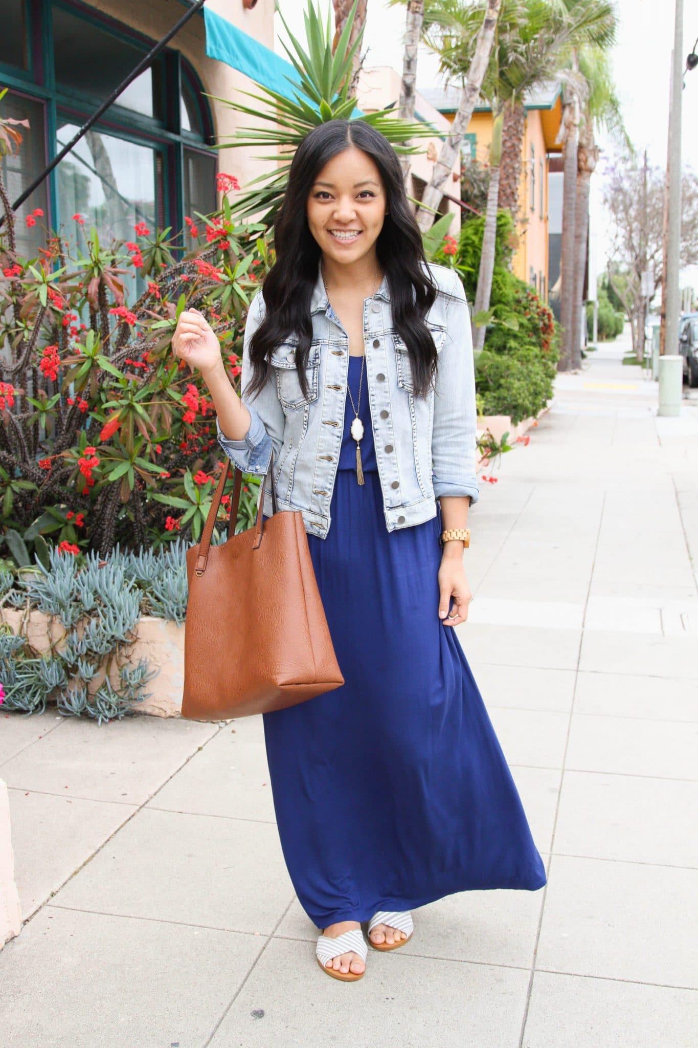 Maxi Dress Outfit: blue maxi dress + denim jacket + slip-on sandals + cognac tote + gold fringe pendant necklace