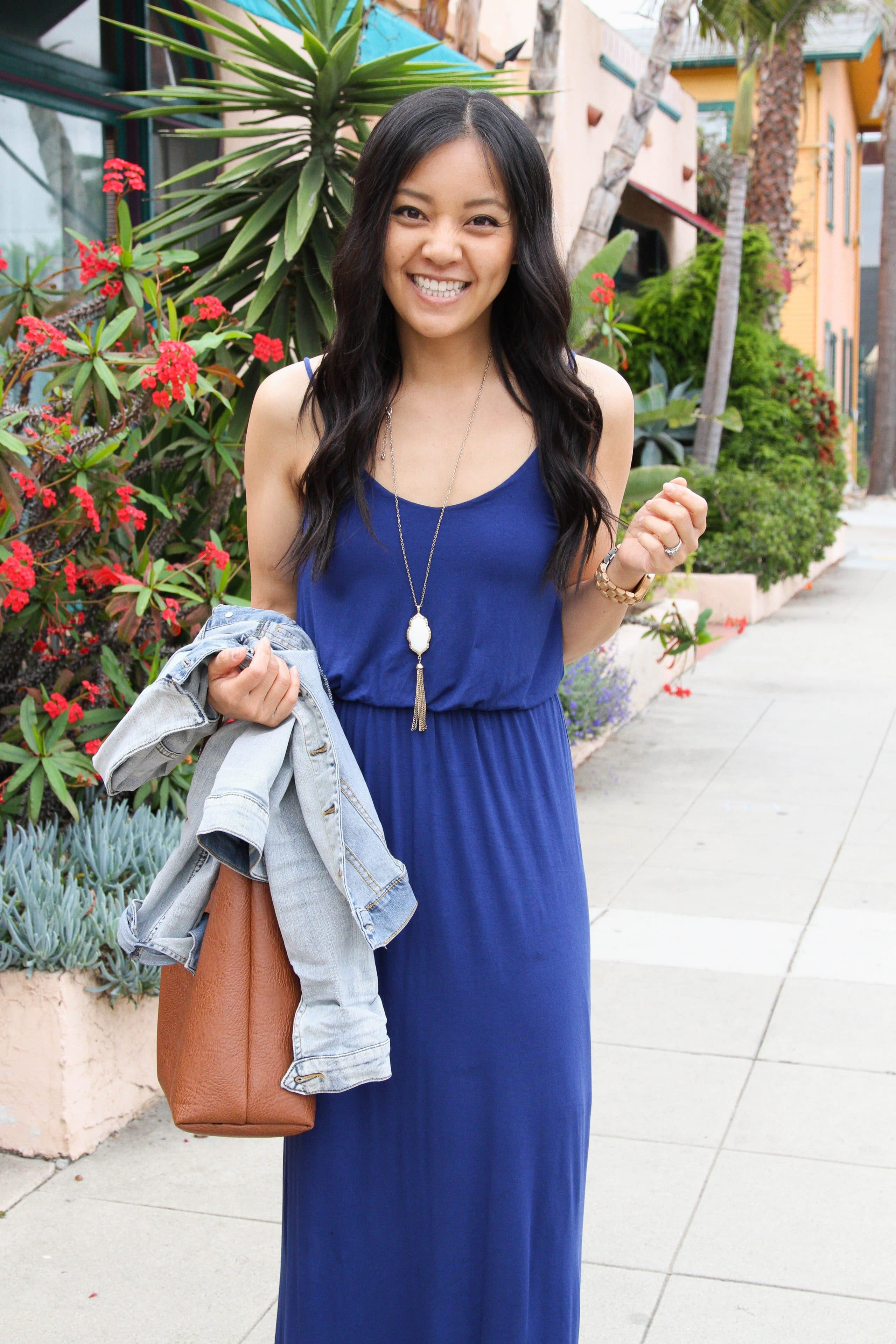 b06d095b1 blue maxi dress, denim jacket off, brown tote and pendant necklace ...
