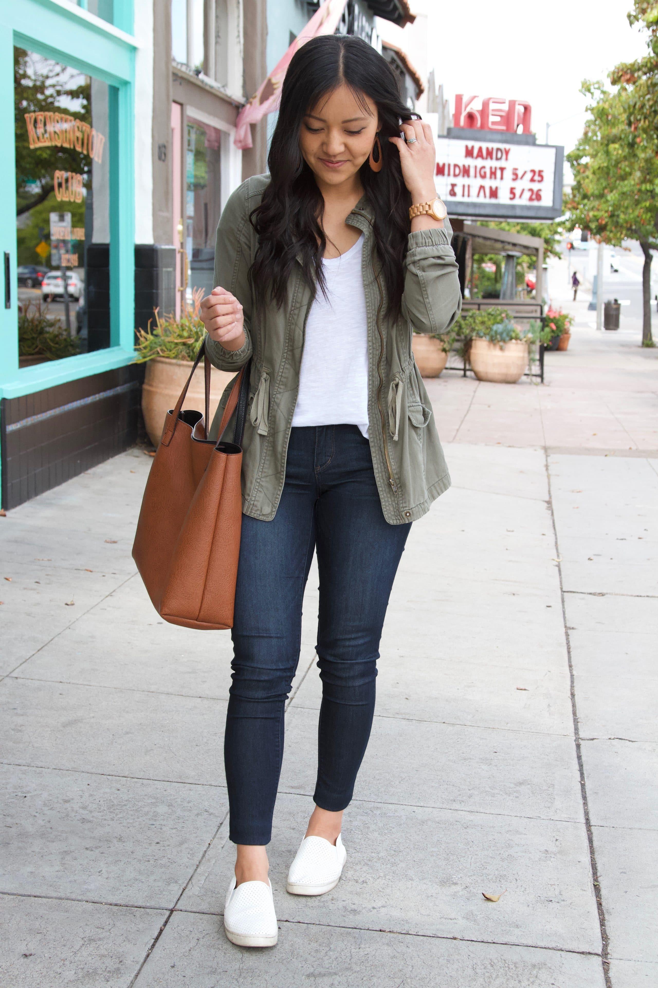 white tee + skinny jeans + white sneakers + utility jacket + brown tote