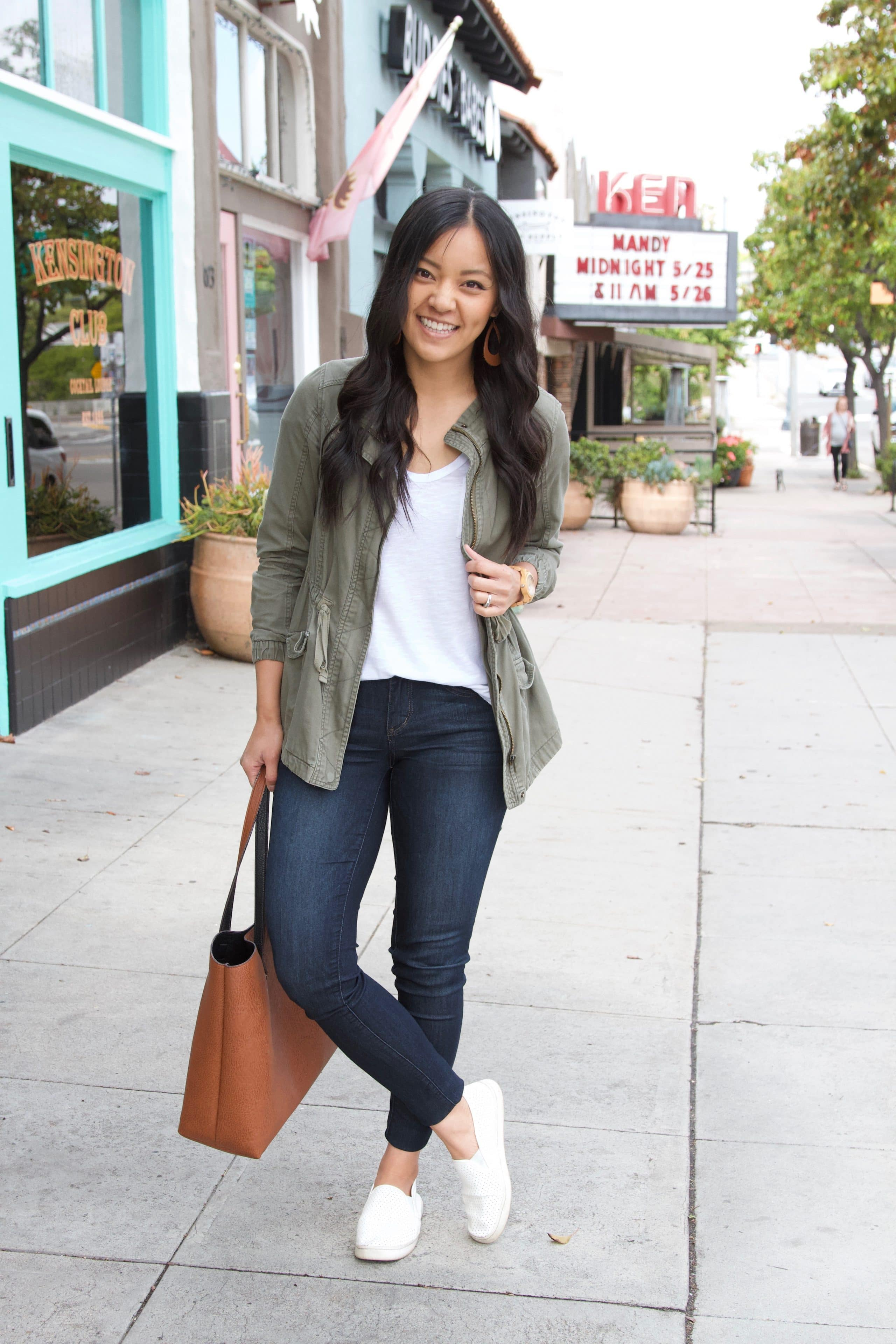 olive utility jacket + skinny jeans + white tee + white sneakers + brown tote