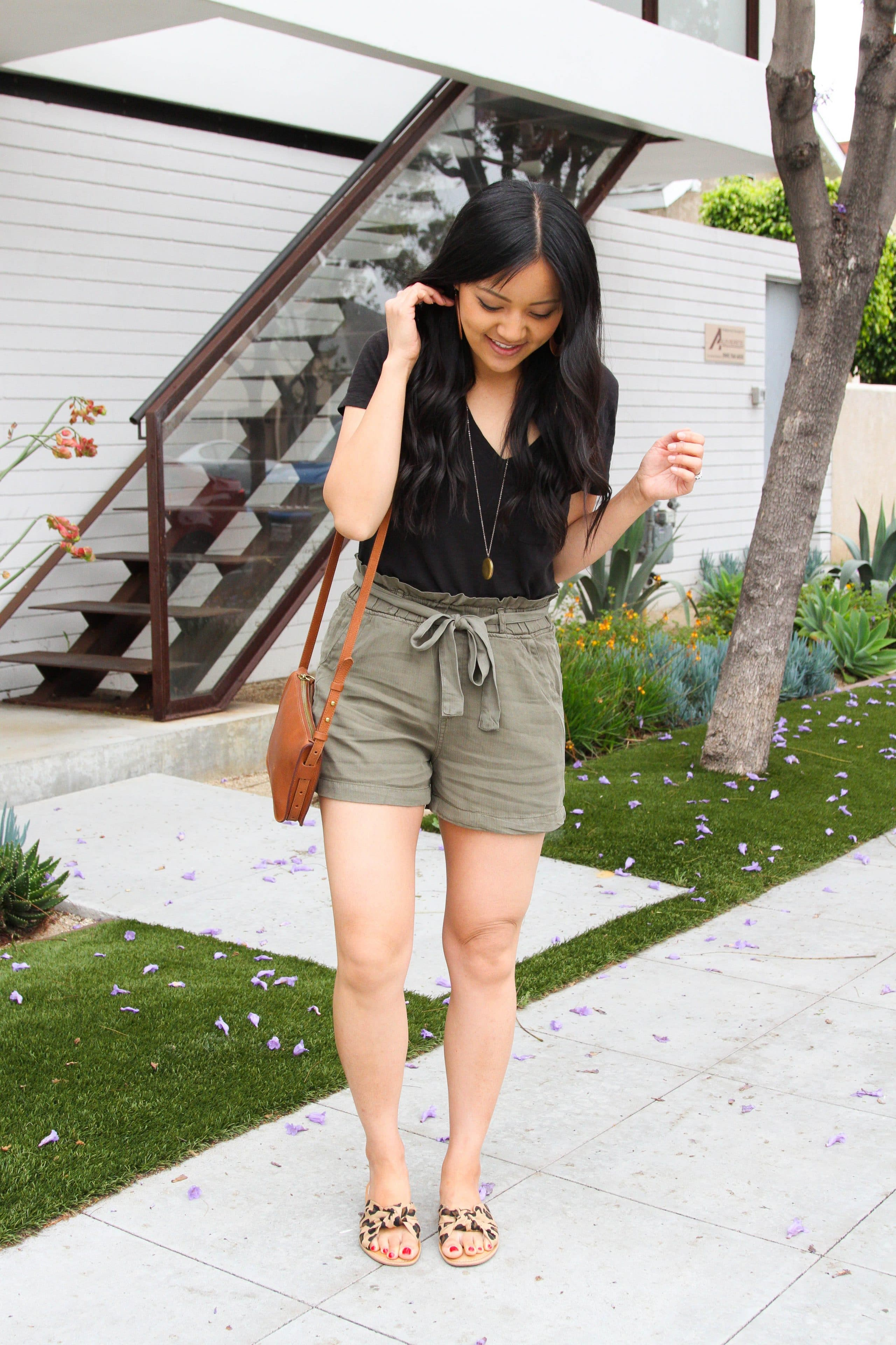 black tee + olive paperbag waist shorts + brown bag + leopard slides
