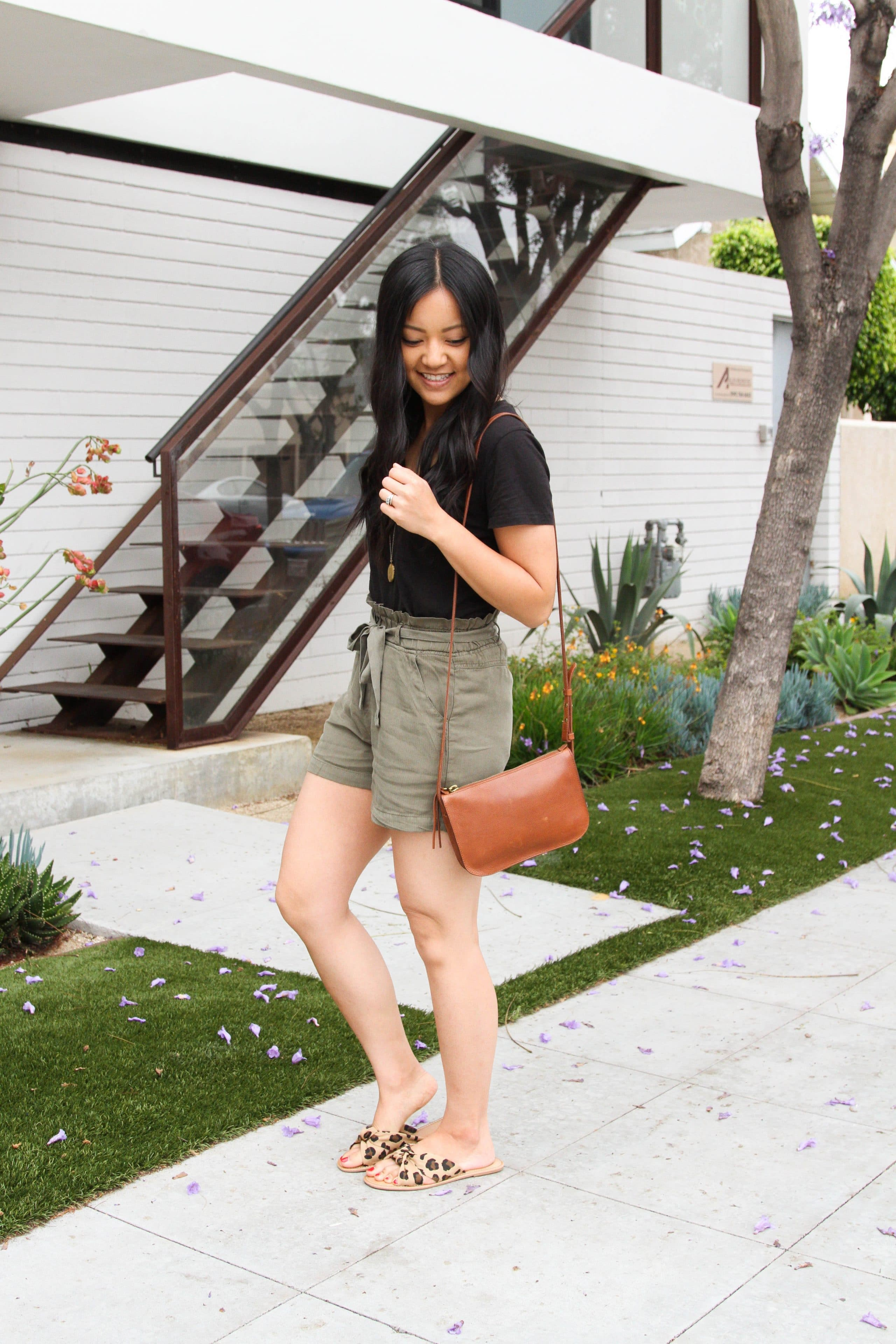Olive shorts + leopard slides + Black Tee + brown bag