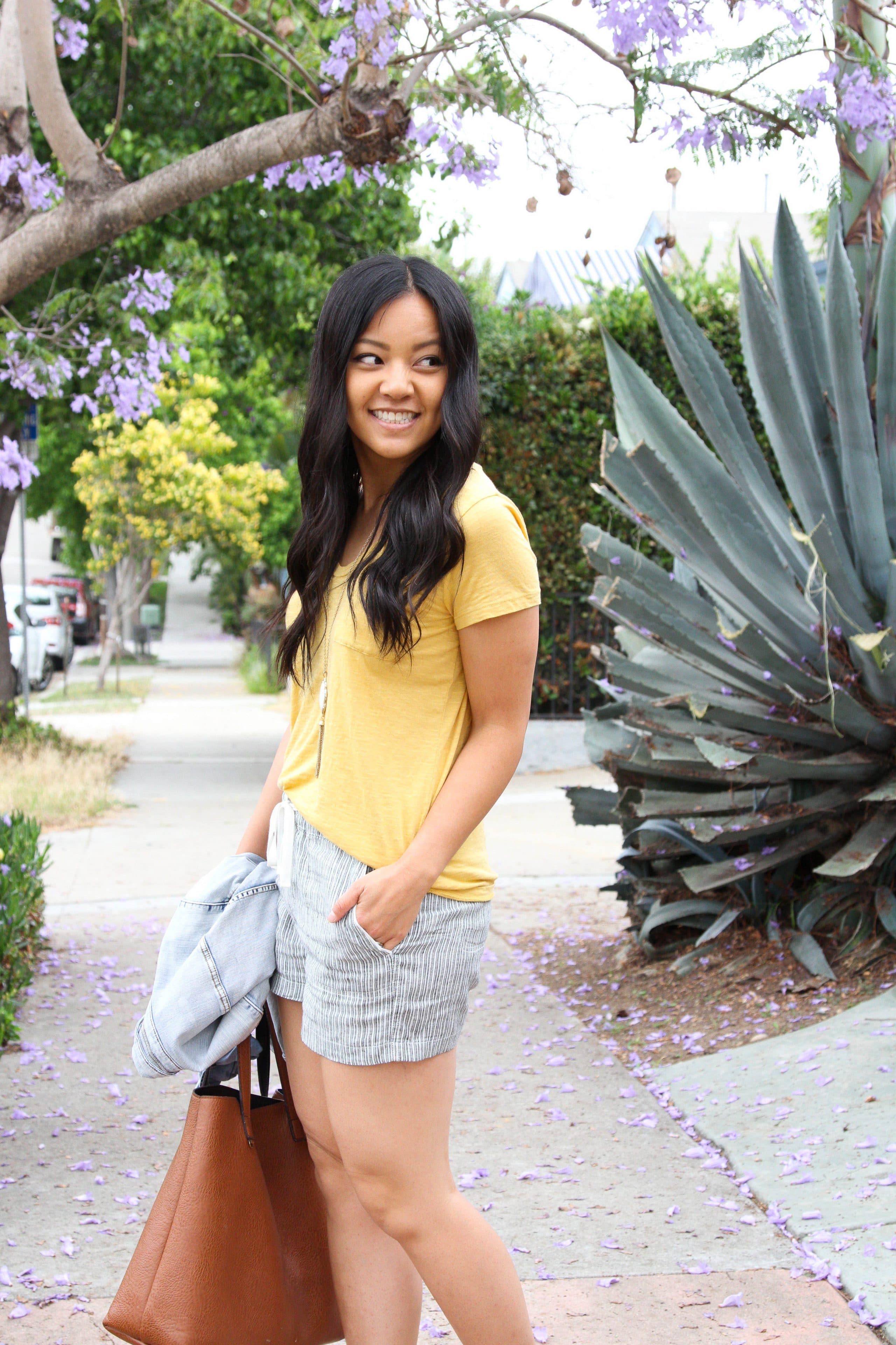 yellow tee + grey shorts + denim jacket + tote